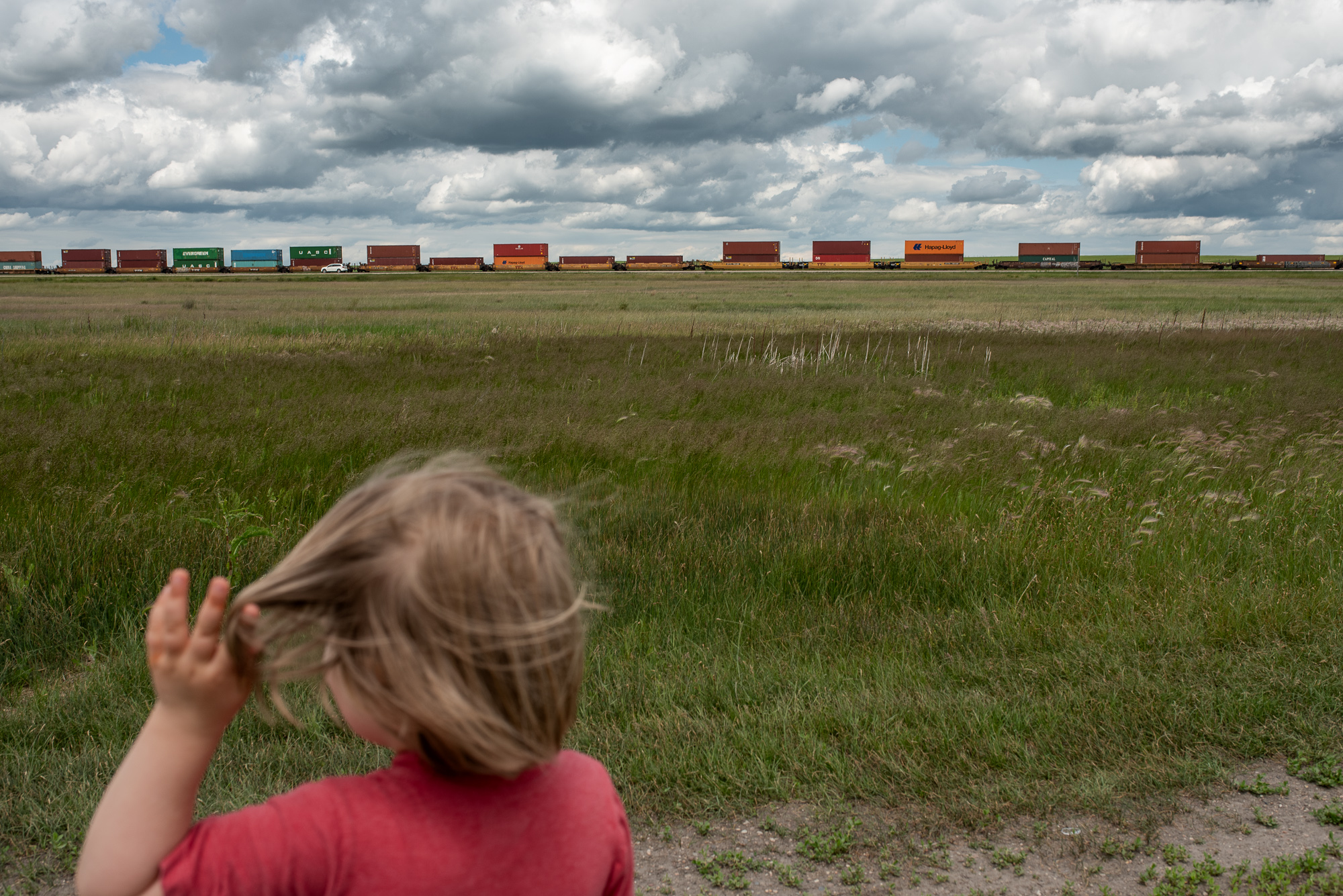 My daughter and I admire the trains on the Prairies. We drove from Vancouver to Ottawa with our three small children this summer to relocate to Canada's capital.