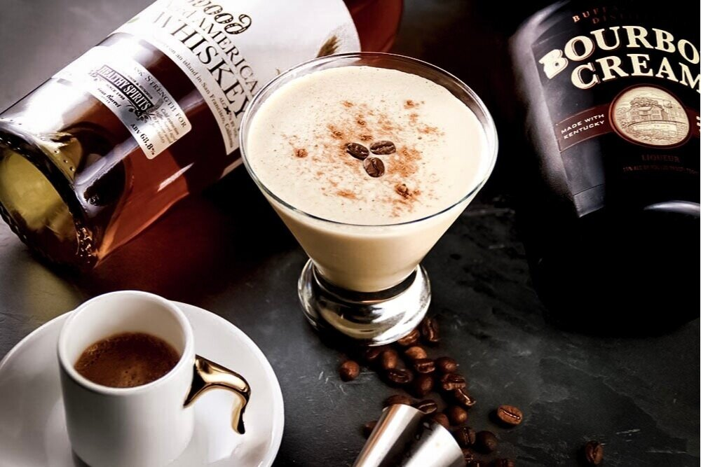 {Kentucky Flat White} - - Doppio Espresso- 1.5 bourbon cream- 1 oz bourbon- CinnamonStir in mixing glass, pour and add hot espresso on top. For cold, combine ingredients in shaker over ice - pour and dash cinnamon with coffee bean garnishRecipe & Photo: Michael Inglima
