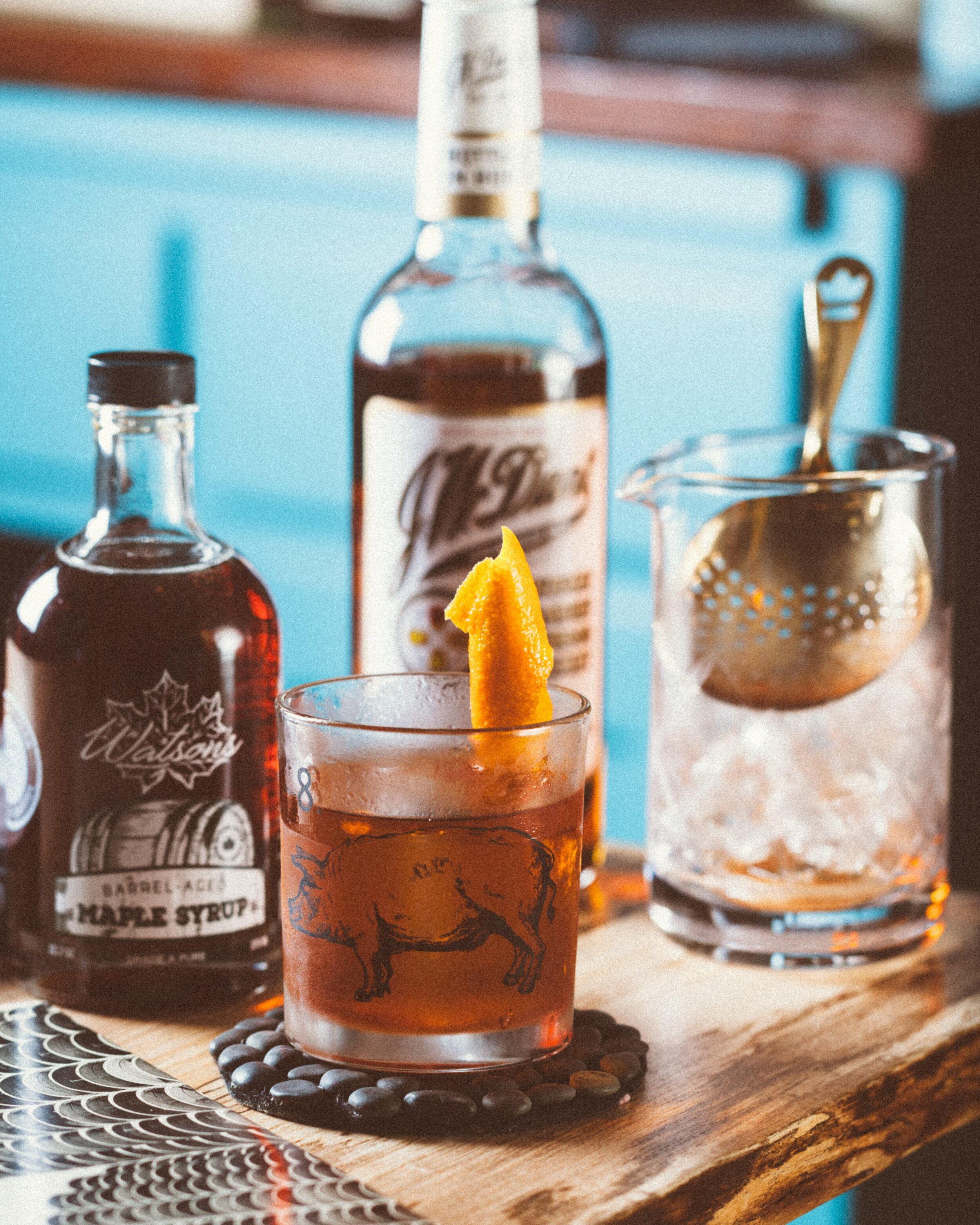 {Benton's Old Fashioned} - - 2oz Benton's bacon infused bourbon- 2 dashes Angostura Bitters- .25oz Watson's Barrel-Aged Maple SyrupStir with ice and then strain over fresh ice and garnish with an expressed orange peel and cherry.Recipe: Jim MeehanPhoto: S. Kallstrand