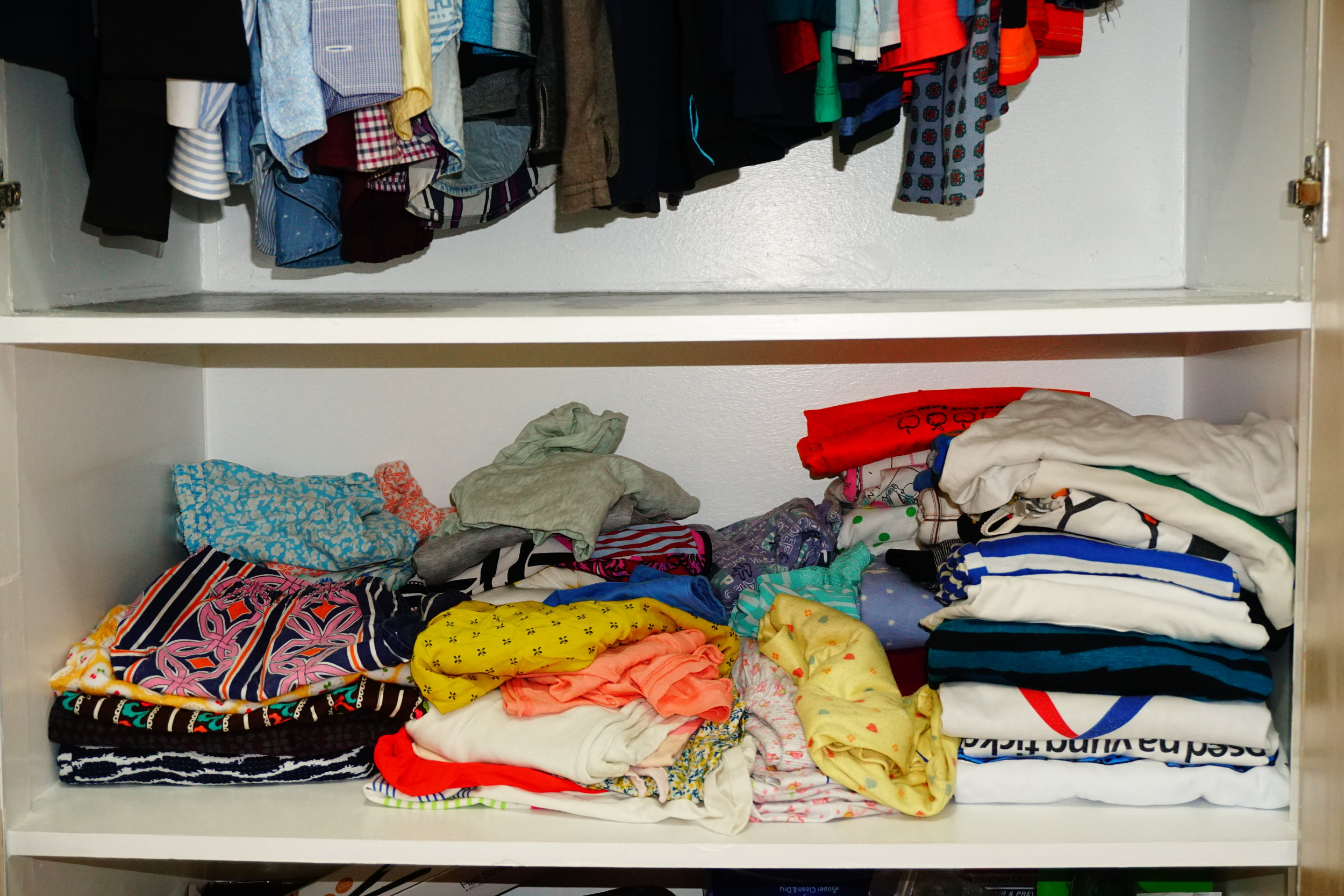 Stacked up clothes that were hard to organize