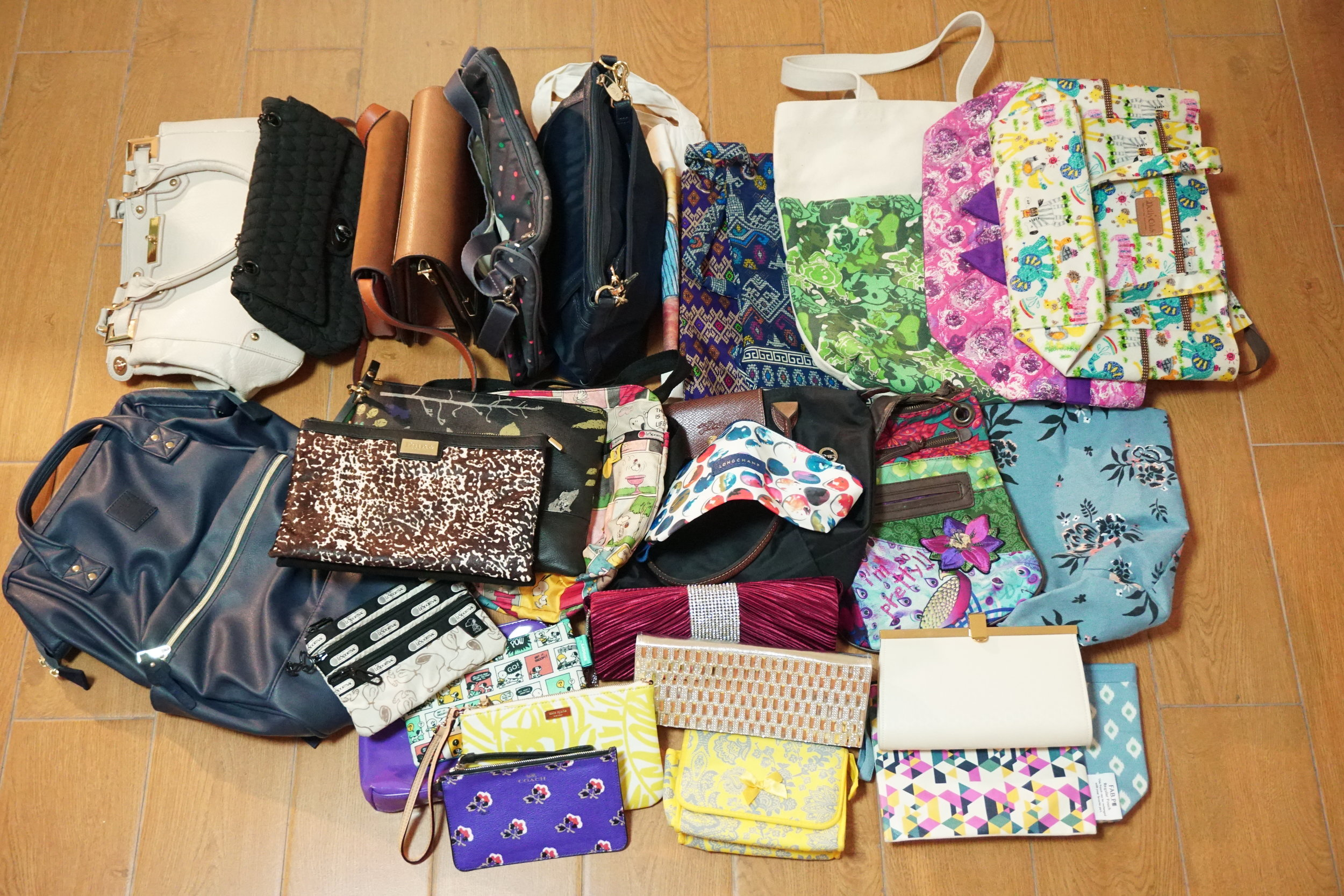 All my handbags taken out from different storage places