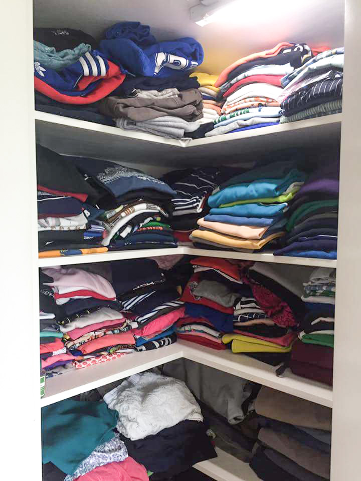 BEFORE - Shelves filled with clothing right up to the top