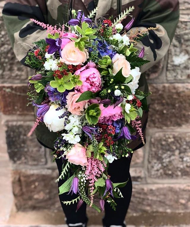 Today's bridal bouquet included so many of our favourite varieties... Peonies, hellebores, astilbe, clematis, lavender and David Austin roses :)
