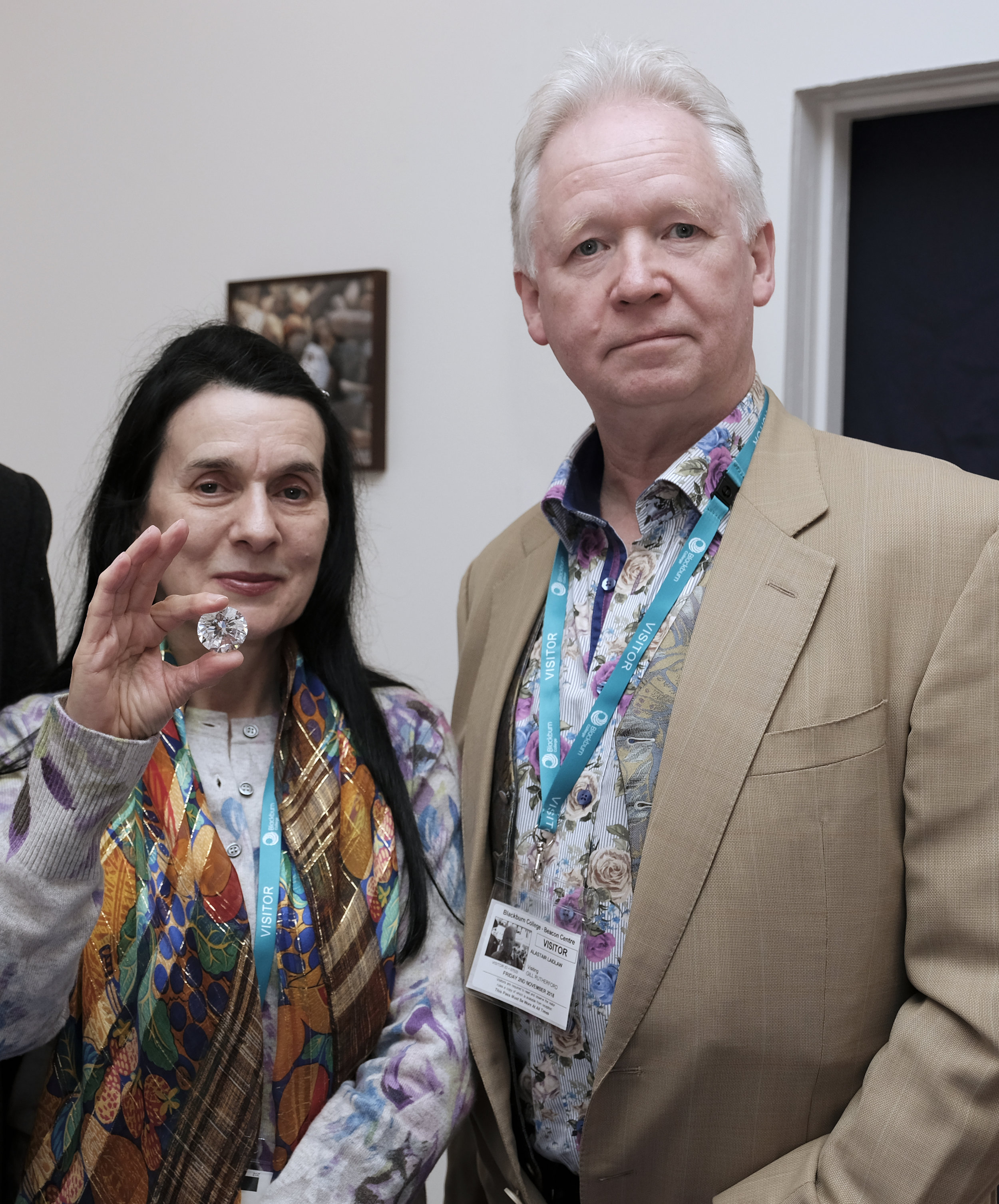 Christine photographed holding a replica of The Cullinan Heritage Diamond, with Alastair