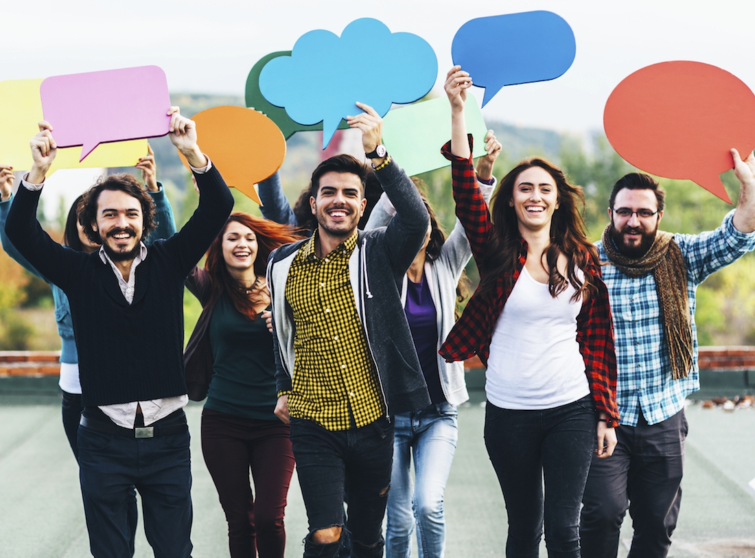 Diverse group of people holding speech bubbles.jpg