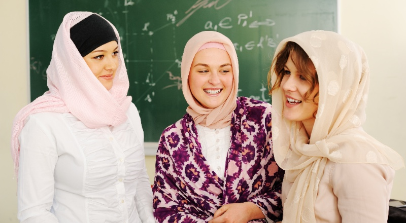 women in headscarves smiling