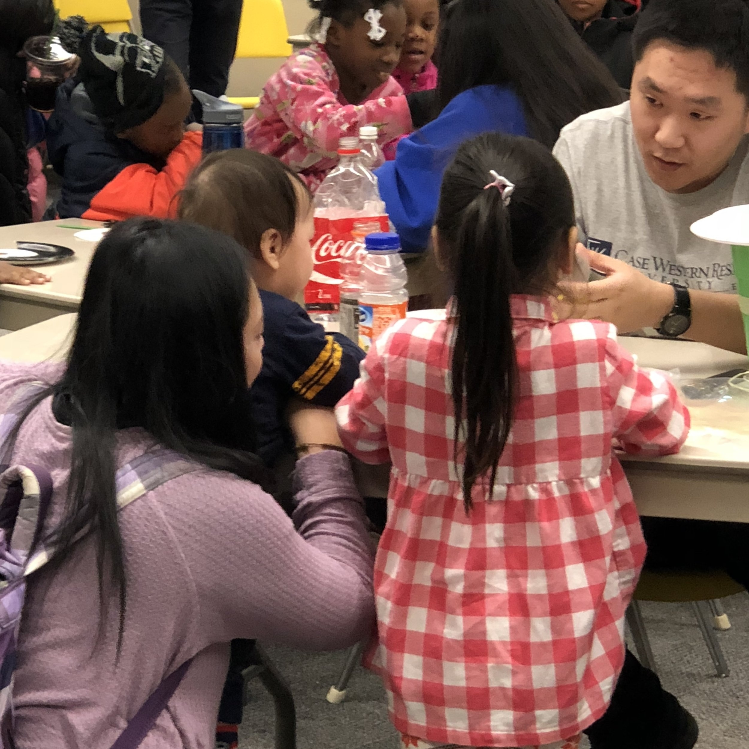 Discovery Day - January 2018Xiaolong Lang teaches local children about polymers.
