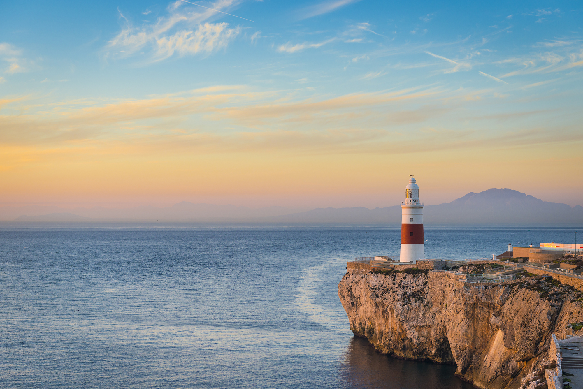The Gibraltar Trinity Lighthouse (Africa in the distance).