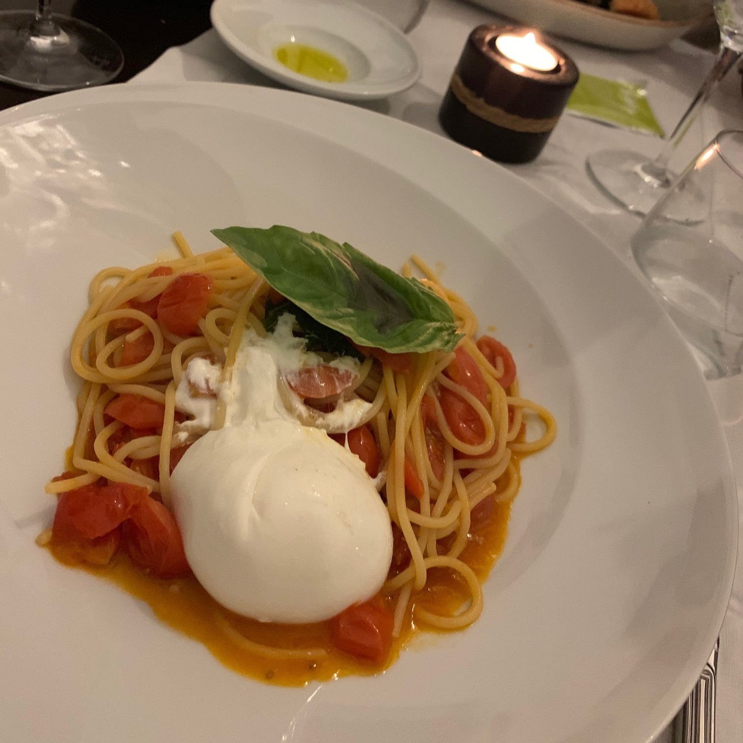 Spaghetti pomodoro topped with basil and burrata from Michel'Angelo