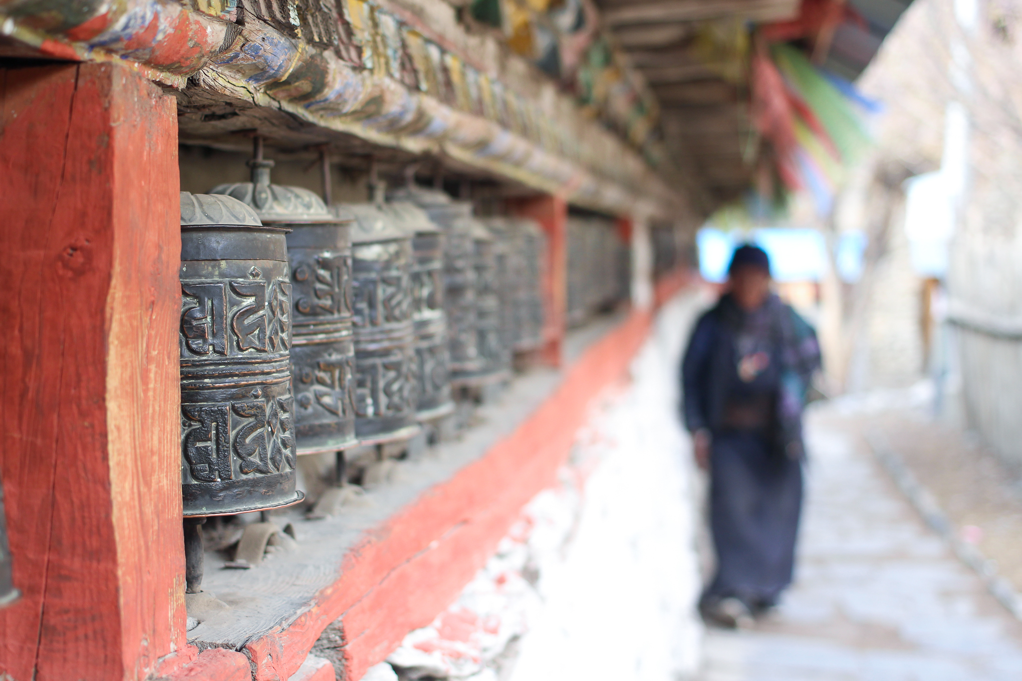 Tibetan Buddhist prayer wheels have rolled up paper inside bearing a mantra, and it is believed that spinning the cylinders emanates positive energy