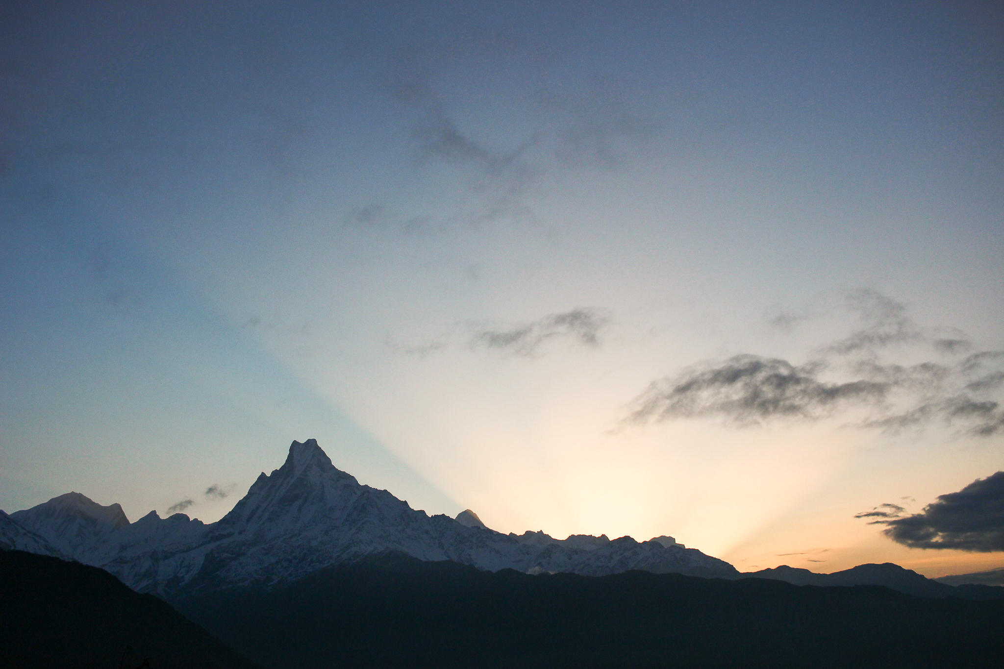 "View of Machapuchare ""the fish tail"" at sunrise from bed in Tadapani… didn't even have to get out from under the covers"