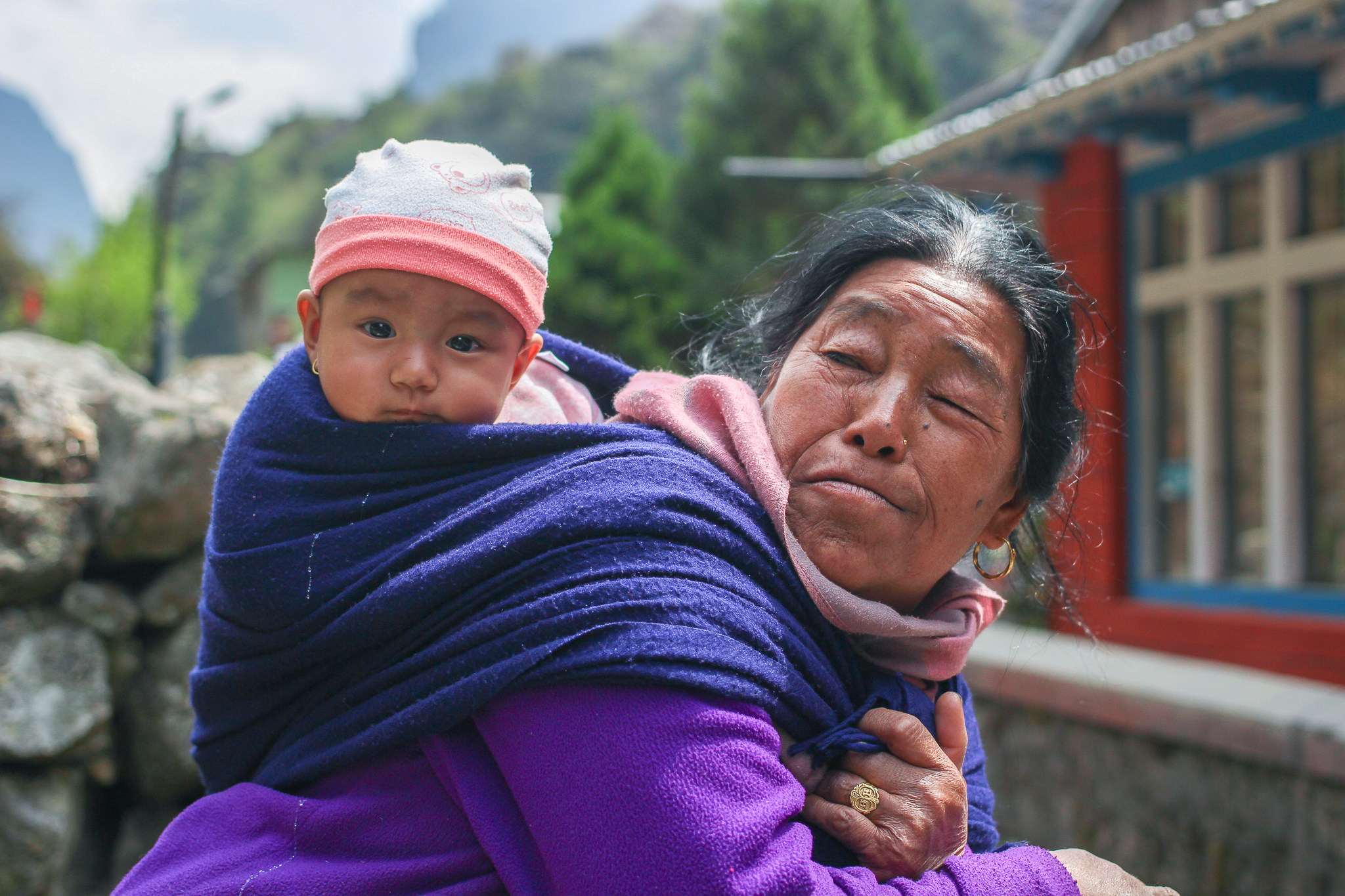 A grandmother and her granddaughter in the pretty village of Tal