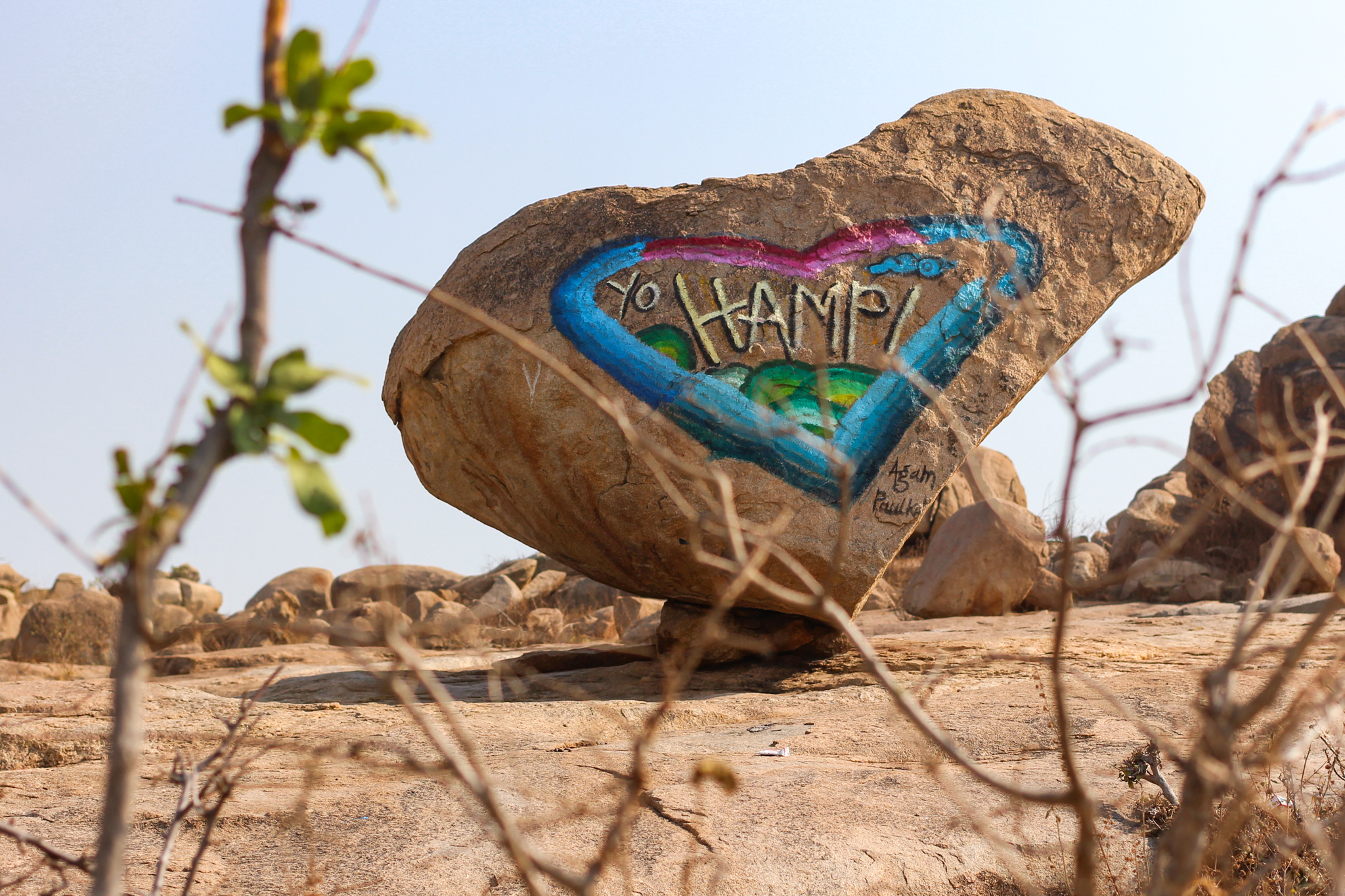 A hand painted boulder I discovered on a scooter ride outside of Hampi