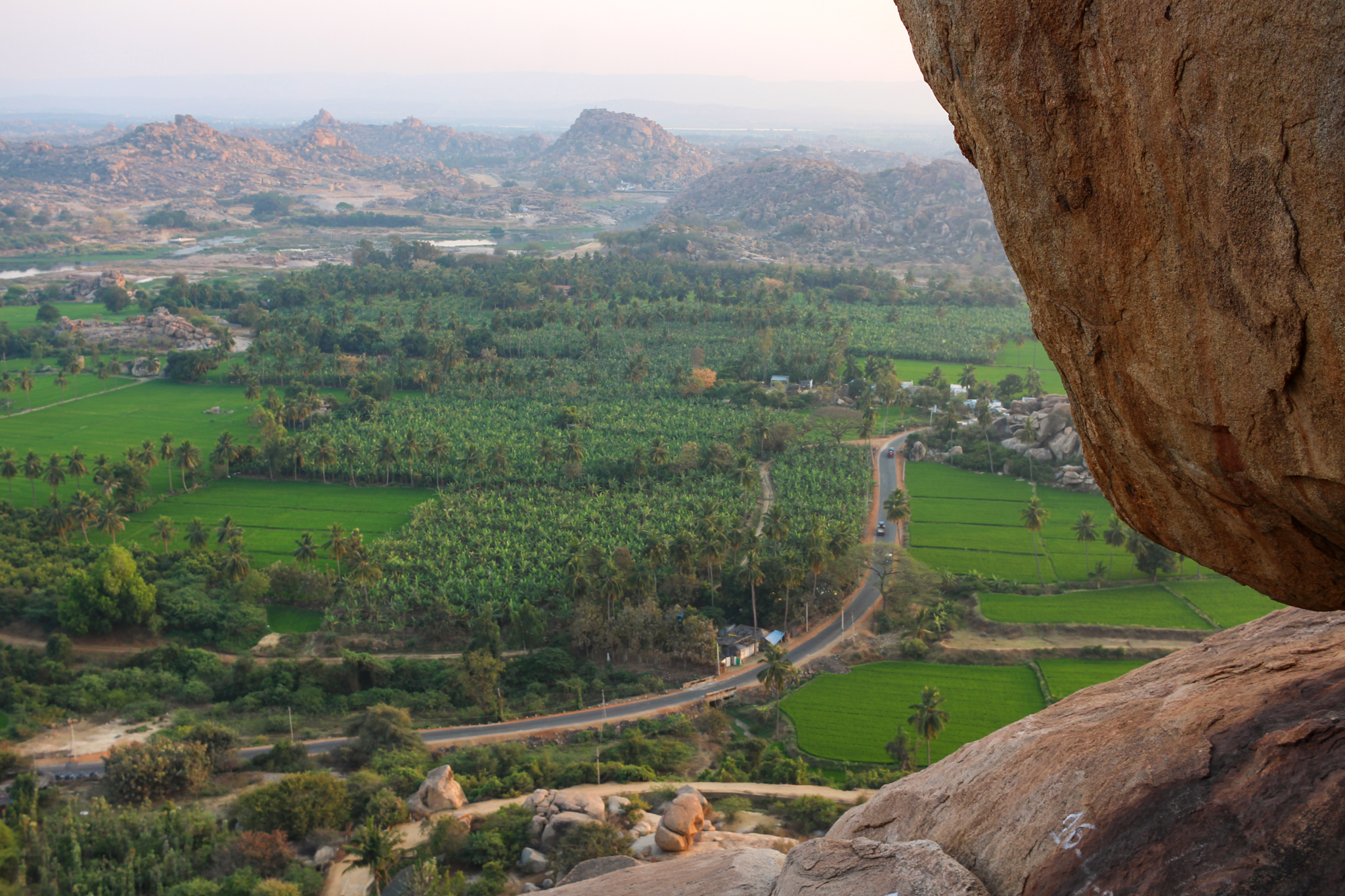 "A surreal landscape of boulders, ancient ruins, rice fields and banana plantations from Hanuman ""Monkey"" Temple"
