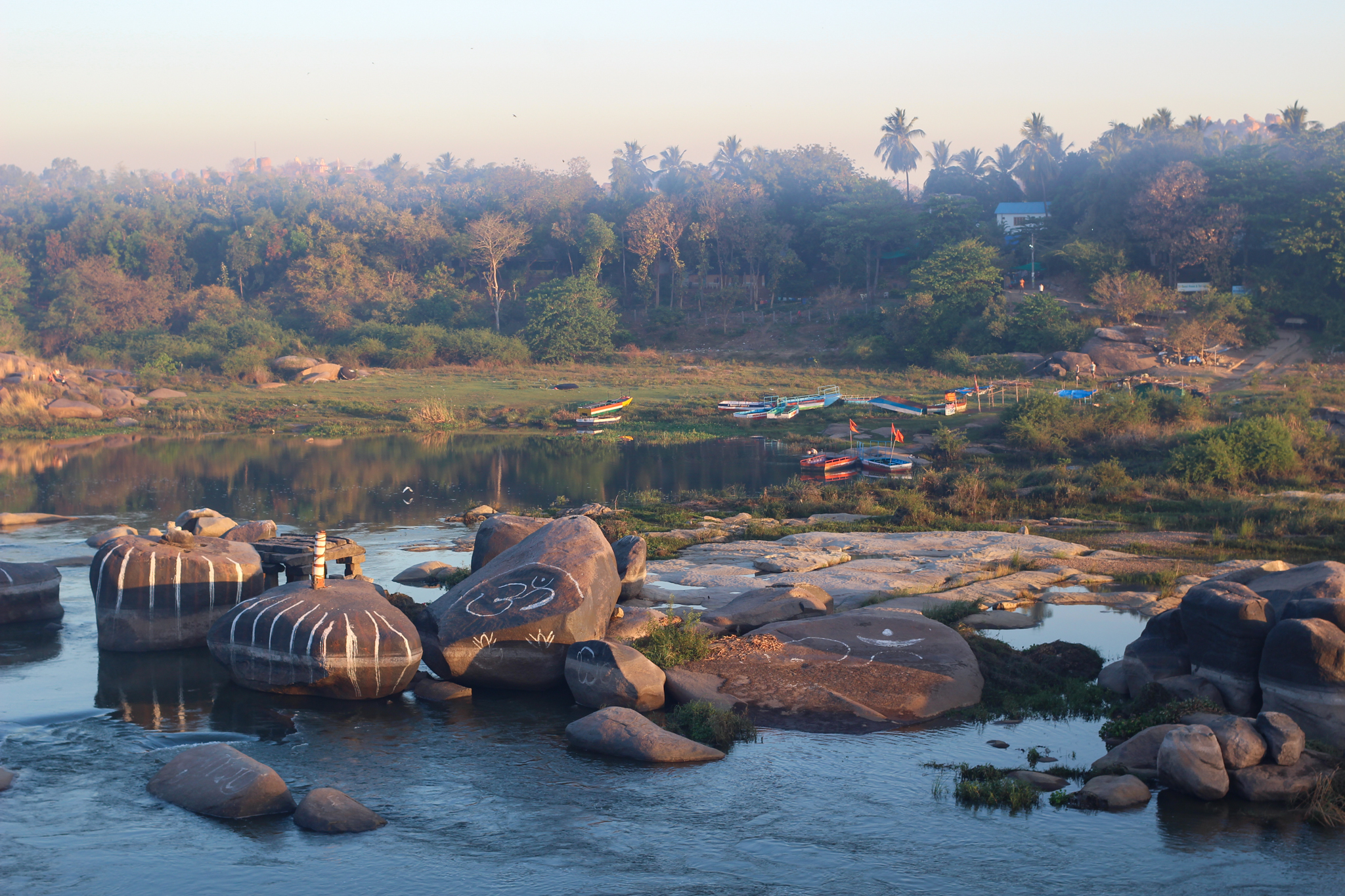 Crossing the river from Hampi Bazaar to Hippy Island by boat at sunrise