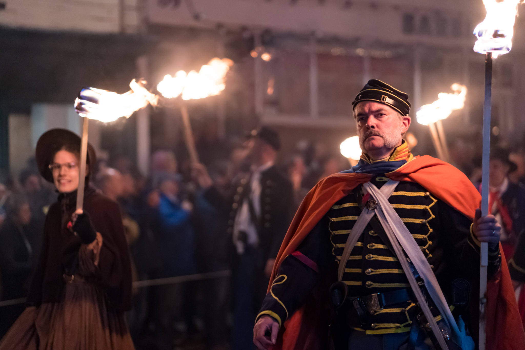 Carrying burning torches through the narrow streets