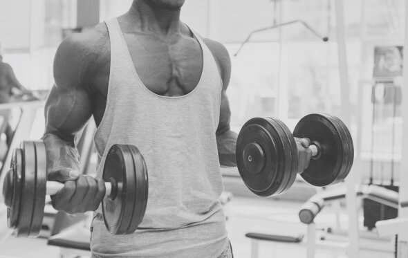 athletic-african-man-working-out-with-dumbbells-gym_130388-52 (1).jpg