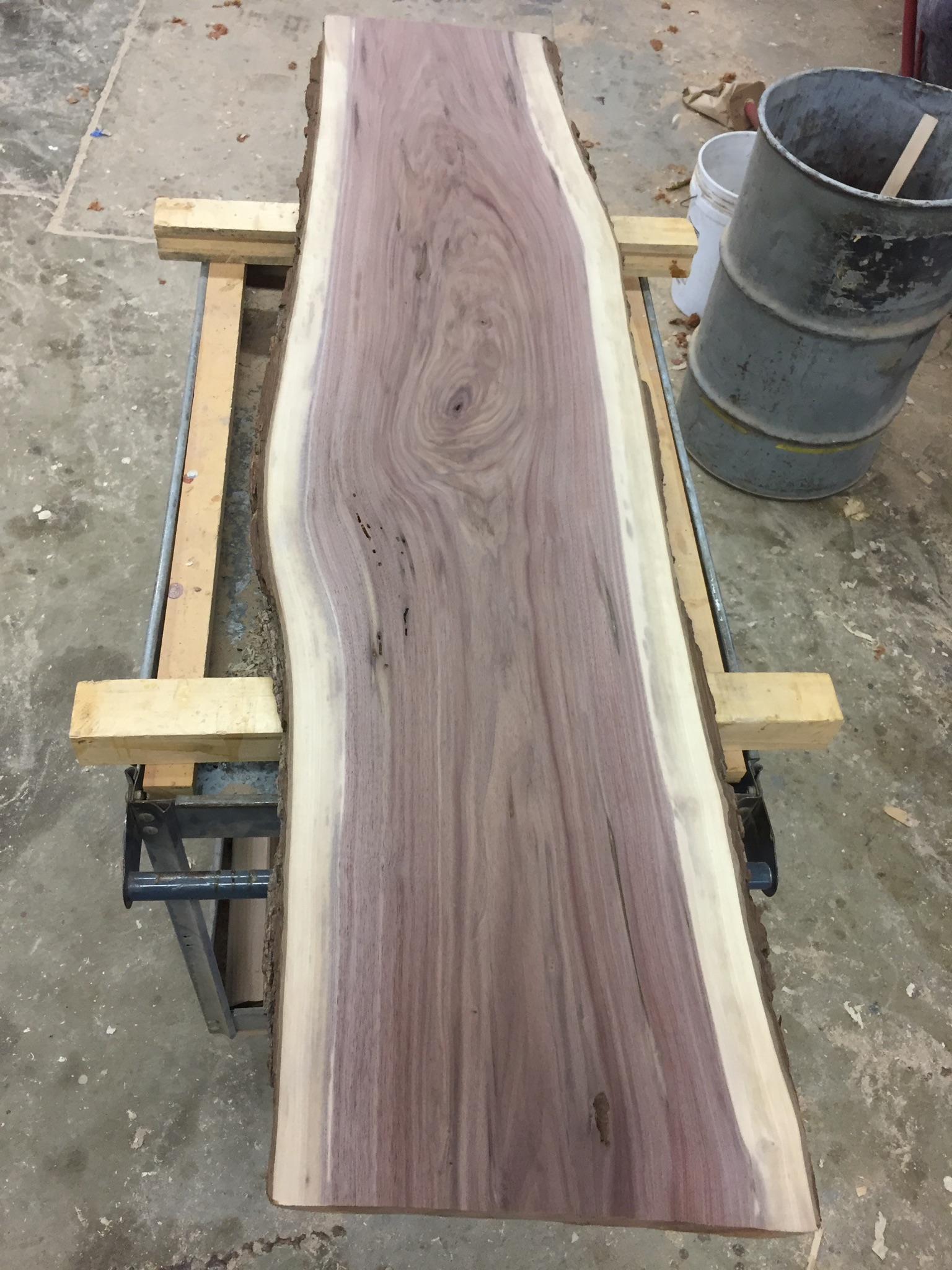 Send it through the wide belt sander to smooth both faces .