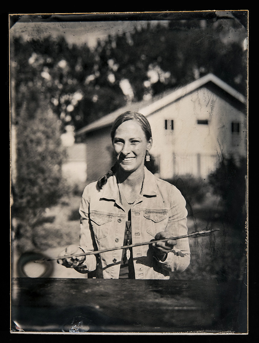 Sabre Moore    Wet Plate Tintype on Aluminum   As executive director of the famous Carter County Museum, Sabre Moore works not only with the incredible, well-known dinosaur fossils from Eastern Montana but also many fine anthropological artifacts. These relics chronicle the details of Carter County and this region's rich human story. Here she is pictured with an in tact arrow from the museum's collections.