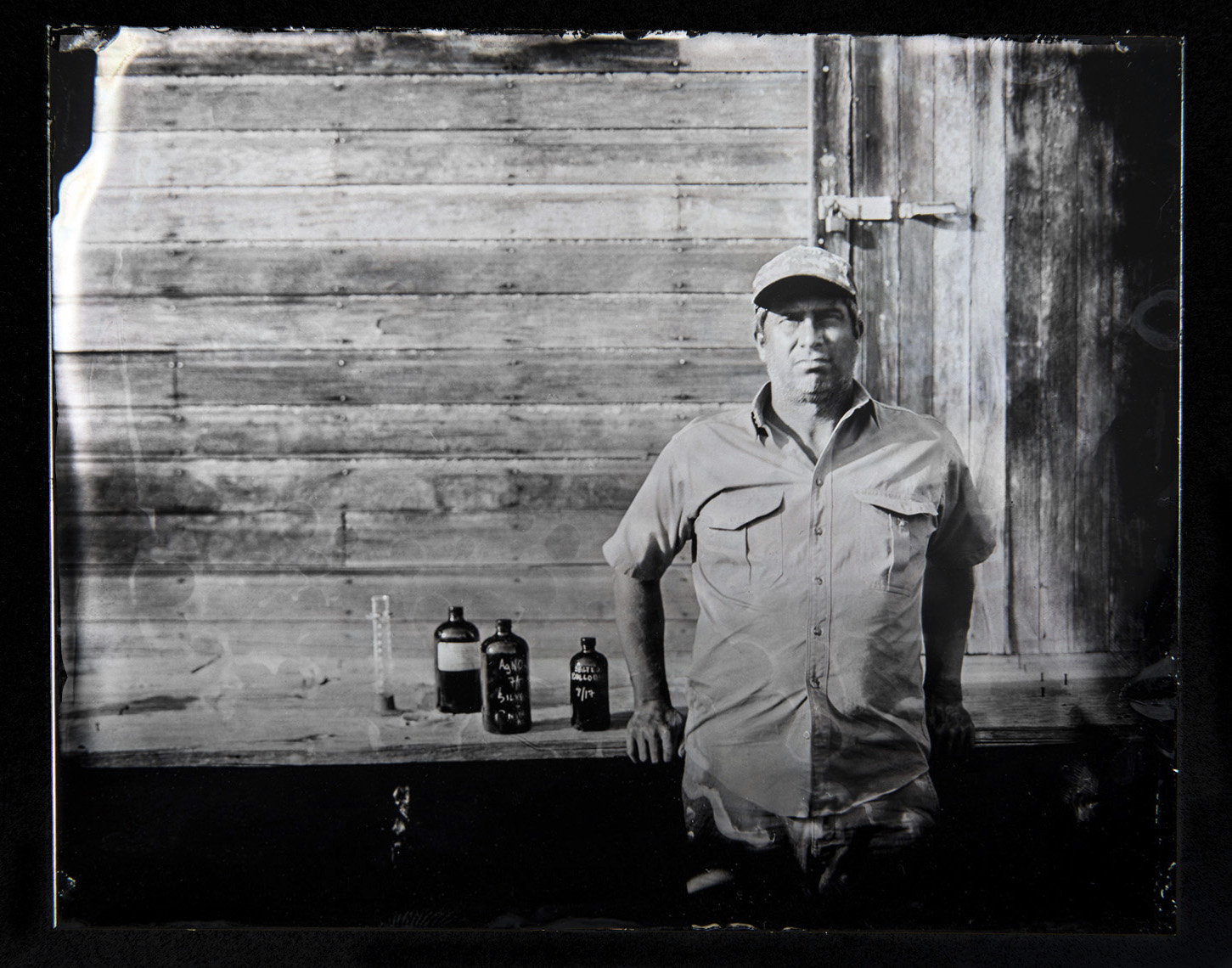 Tom Fowlks    Wet Plate Tintype on Aluminum   Photographer Tom Fowlks photographed here with the wet plate chemistry in Lusk, Wyoming.