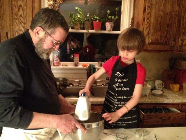 Jim teaching our grandson to bake