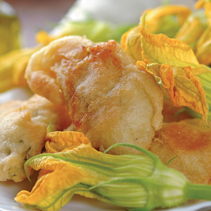 ZUCCHINI FLOWERS WITH MOZZARELLA - Our delicate squash blossoms are hand selected and carefully stuffed with fresh mozzarella. They are lightly battered and frozen to lock in their subtle taste and texture.Item 02017 // Case Pack: Approx. 80/1.76 oz. // Case Net Wt: 8.8 lbs. // Product of Sicily // MORE INFO