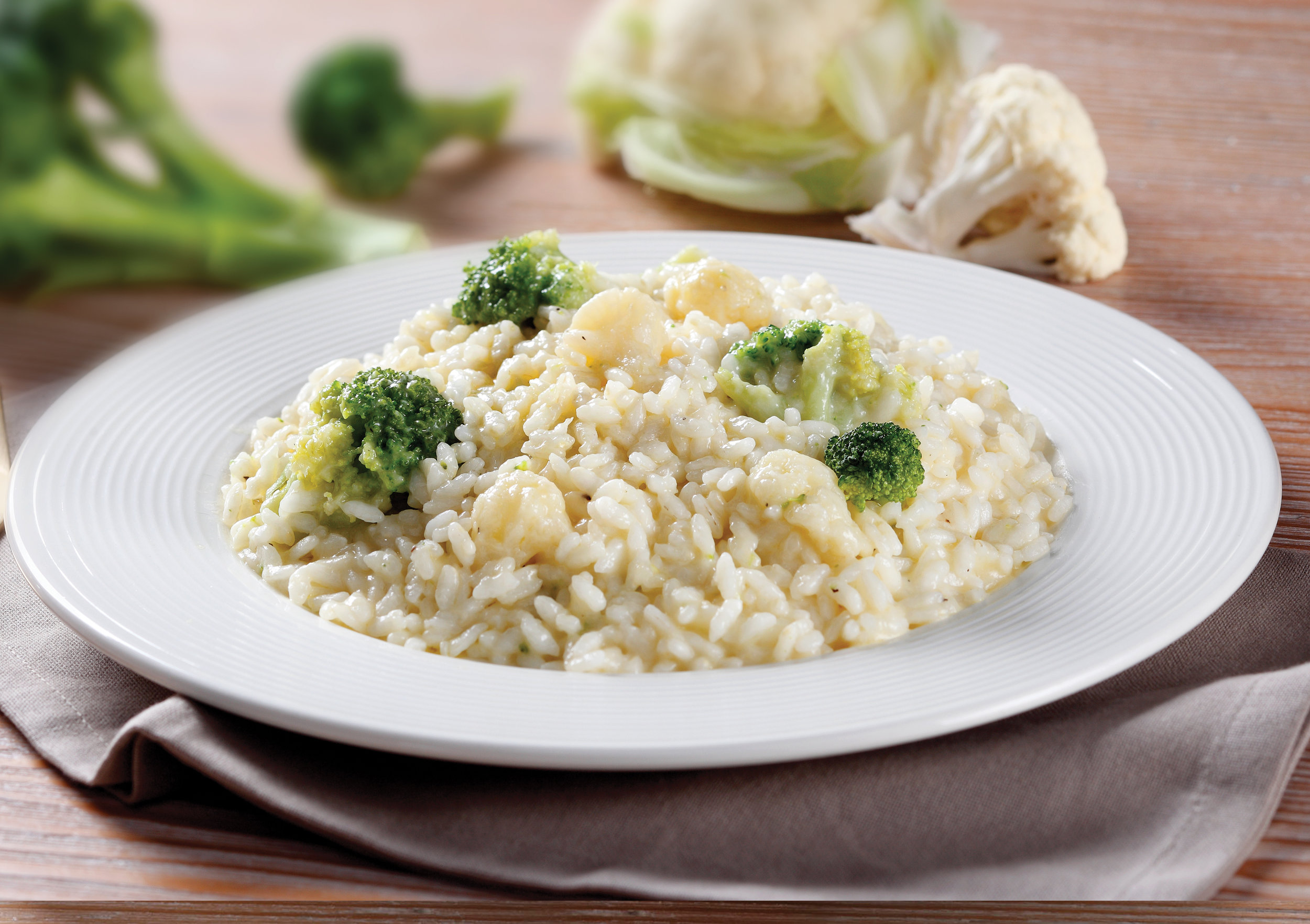 RISOTTO WITH CAULIFLOWER & BROCCOLI - This ready to cook and serve Risotto is made with our imported Carnaroli Rice and includes a rich and creamy blend of Grana Padano cheese, plus fresh chopped cauliflower and broccoli.Item 02012  //  Case Pack: 12/10.58 oz. bags  //  Case Net Wt: 7.9 lbs.  //  Product of Italy  //  MORE INFO