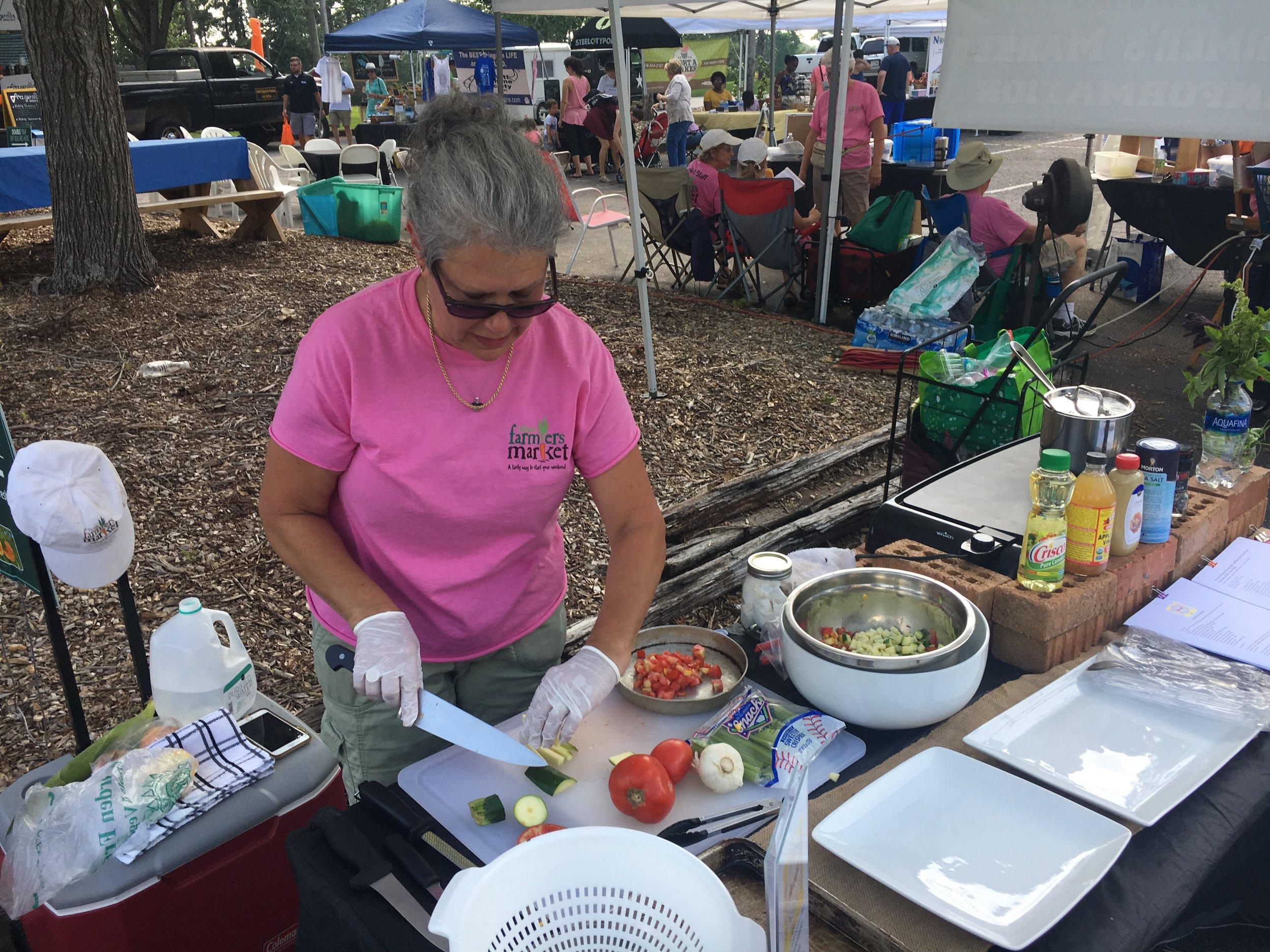 Chef Lisa Lowe Preparing a Summer Succotash at the Lilburn Farmers Market for the Nourish! Program