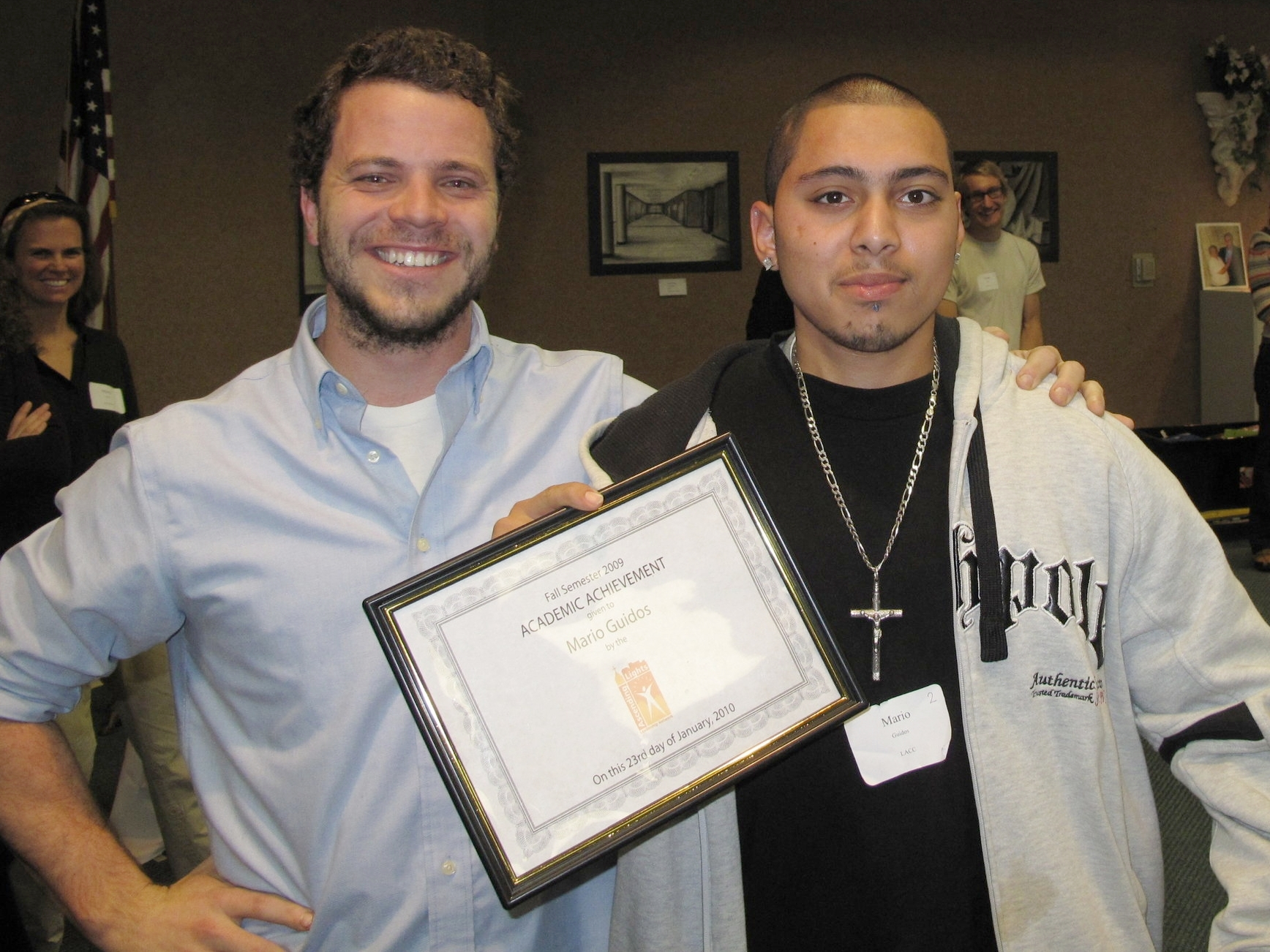 Mario Guidos (right) of Saint Michael's Catholic Church receives an academic achievement award from his mentor, 2009