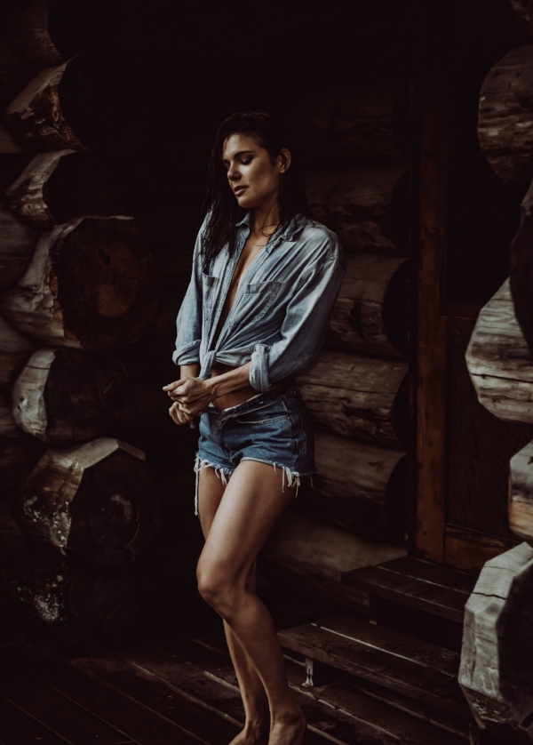 Intimate photography outdoors at wood cabin woman in jean shorts boudoir photography new york city