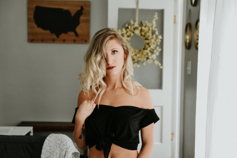 Blonde woman in black tied up shirt boudoir photography new york studio