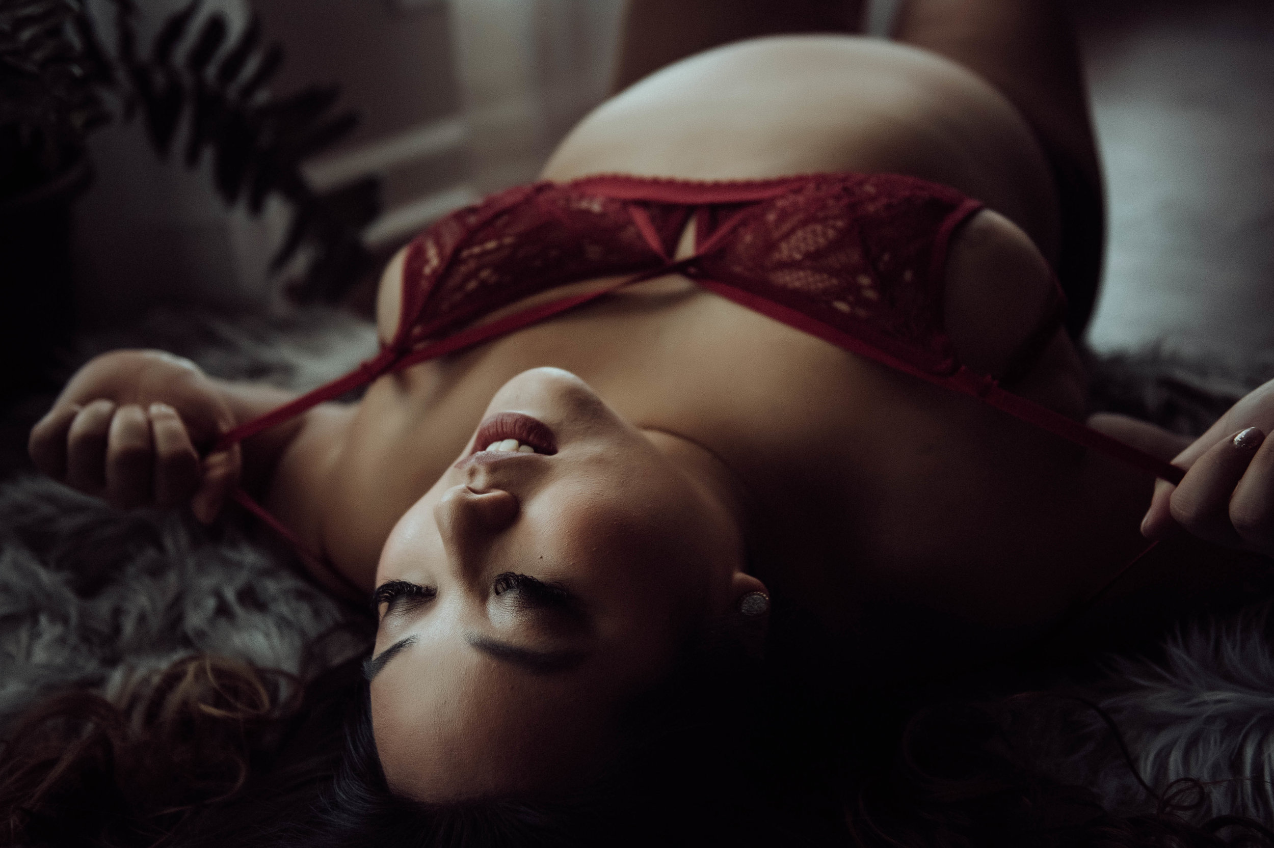 Plus size asian woman in red bra fur rug boudoir photography new york studio
