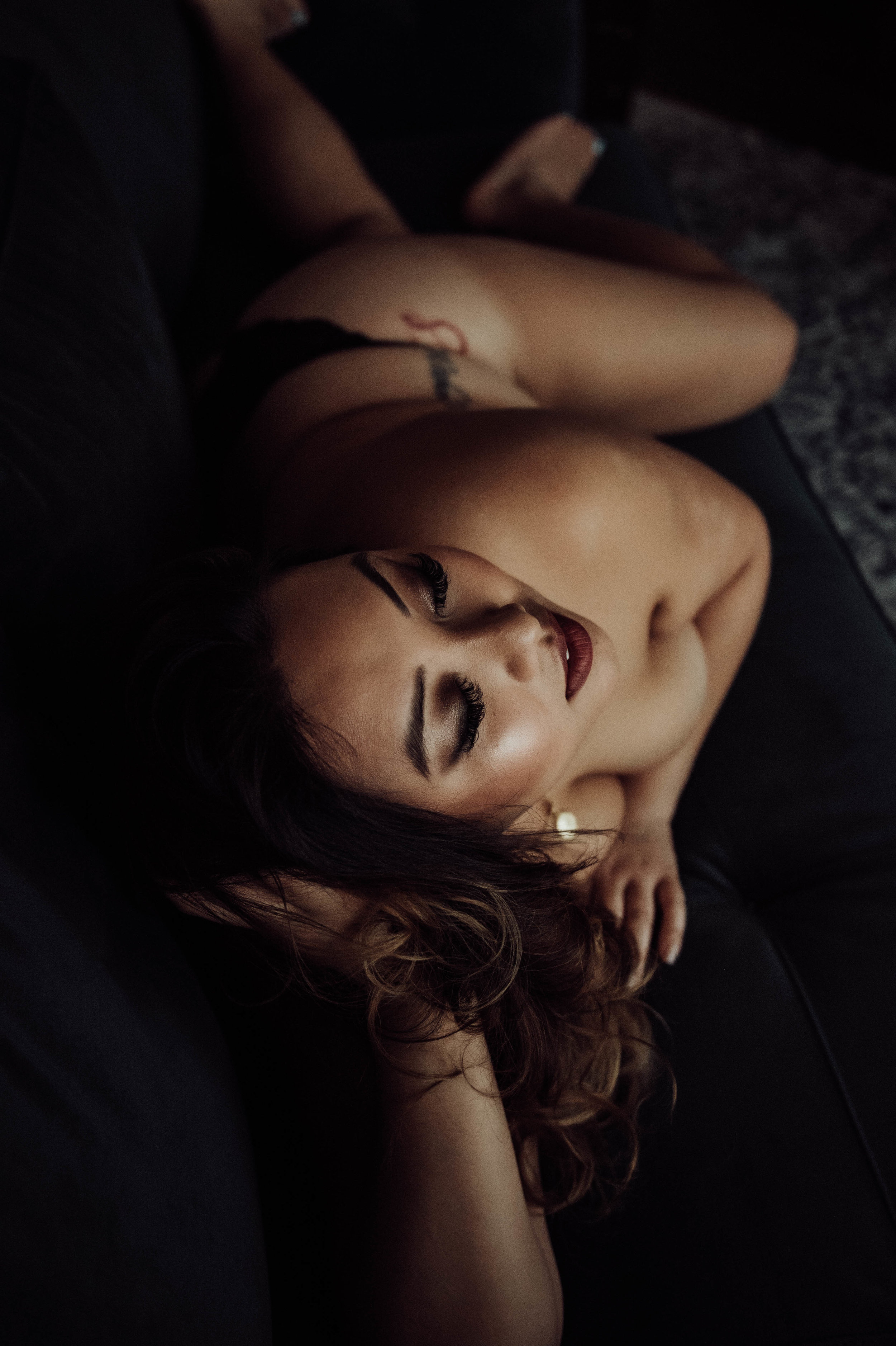 Nude Plus size asian woman laying on couch boudoir photography new york studio
