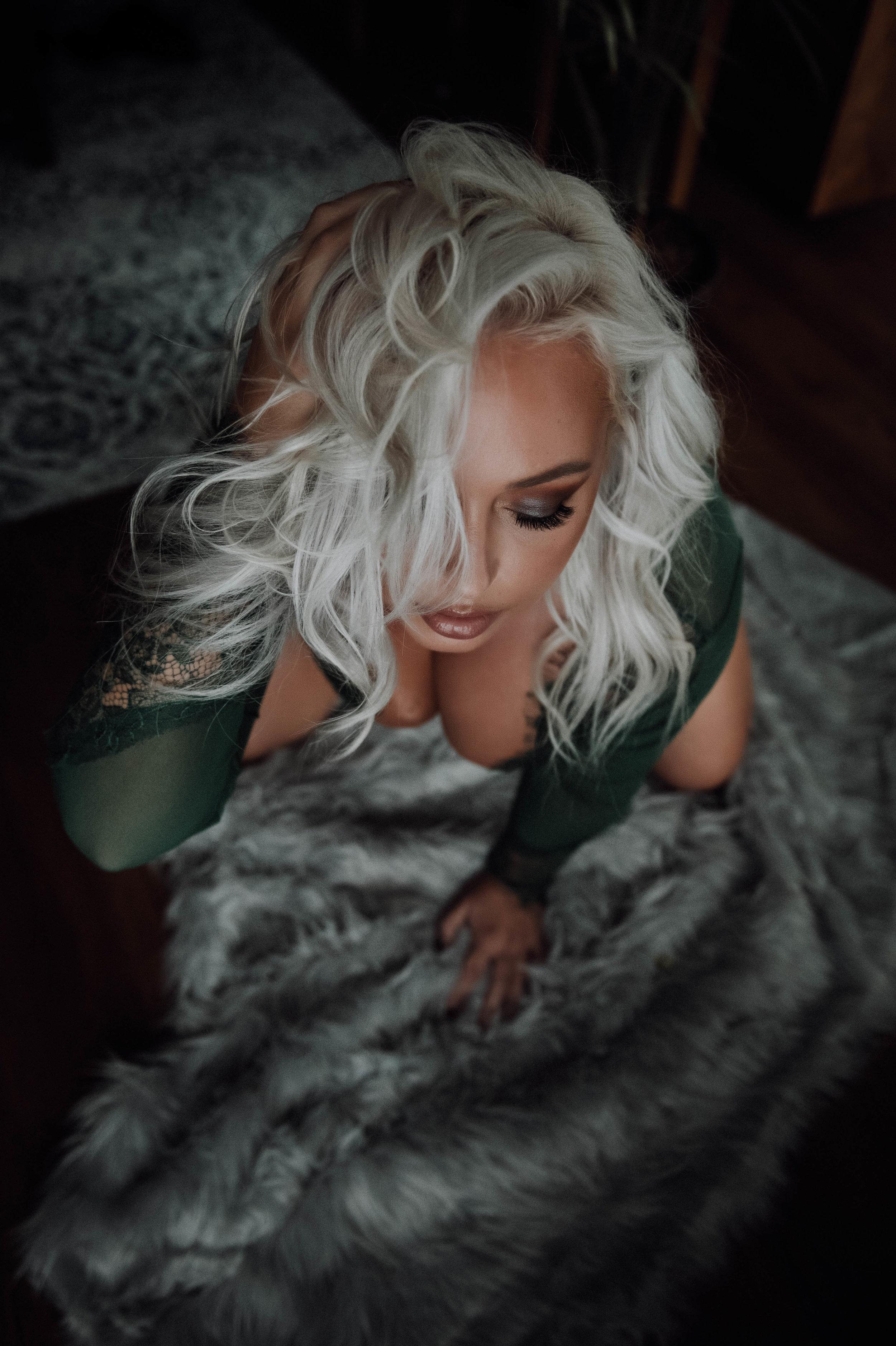 blonde woman in green bodysuit on gray rug boudoir photography new york city studio