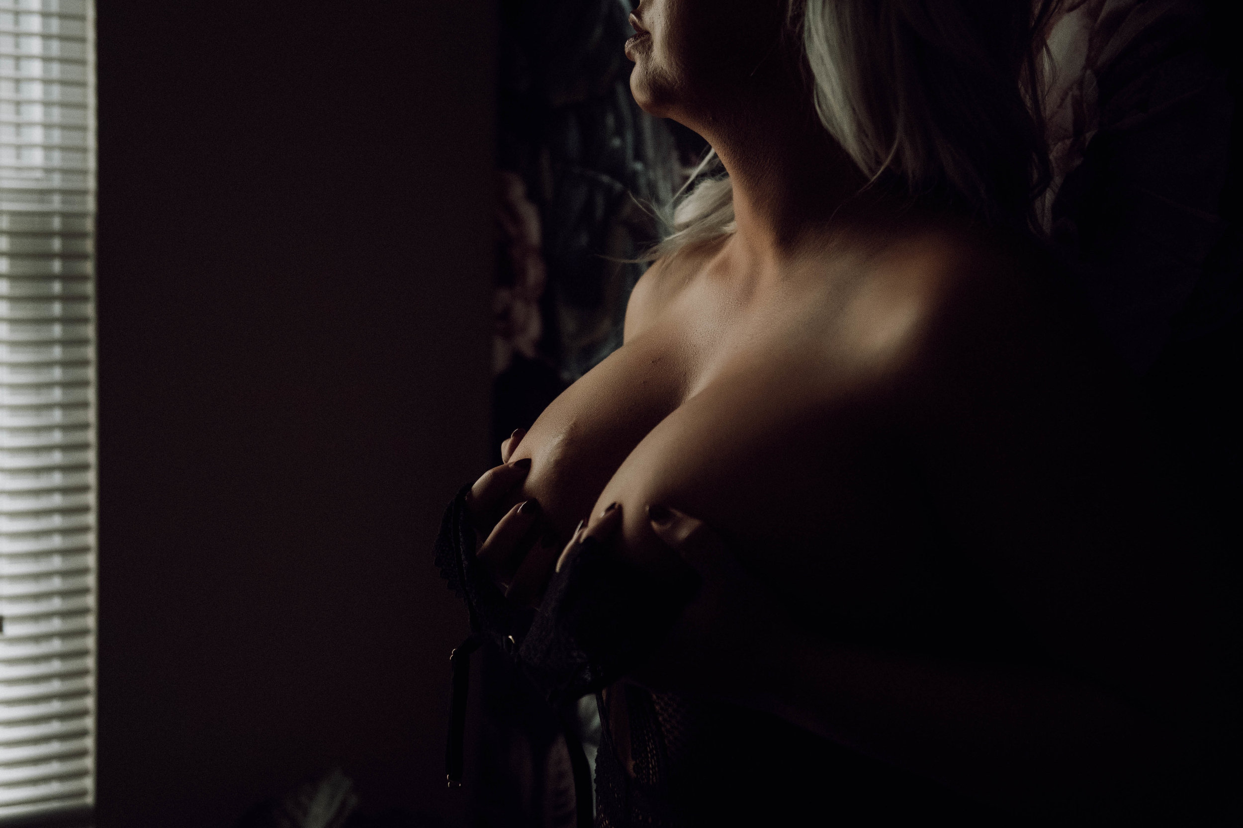Nude intimate photography of blonde with silhouette boudoir photography New York City