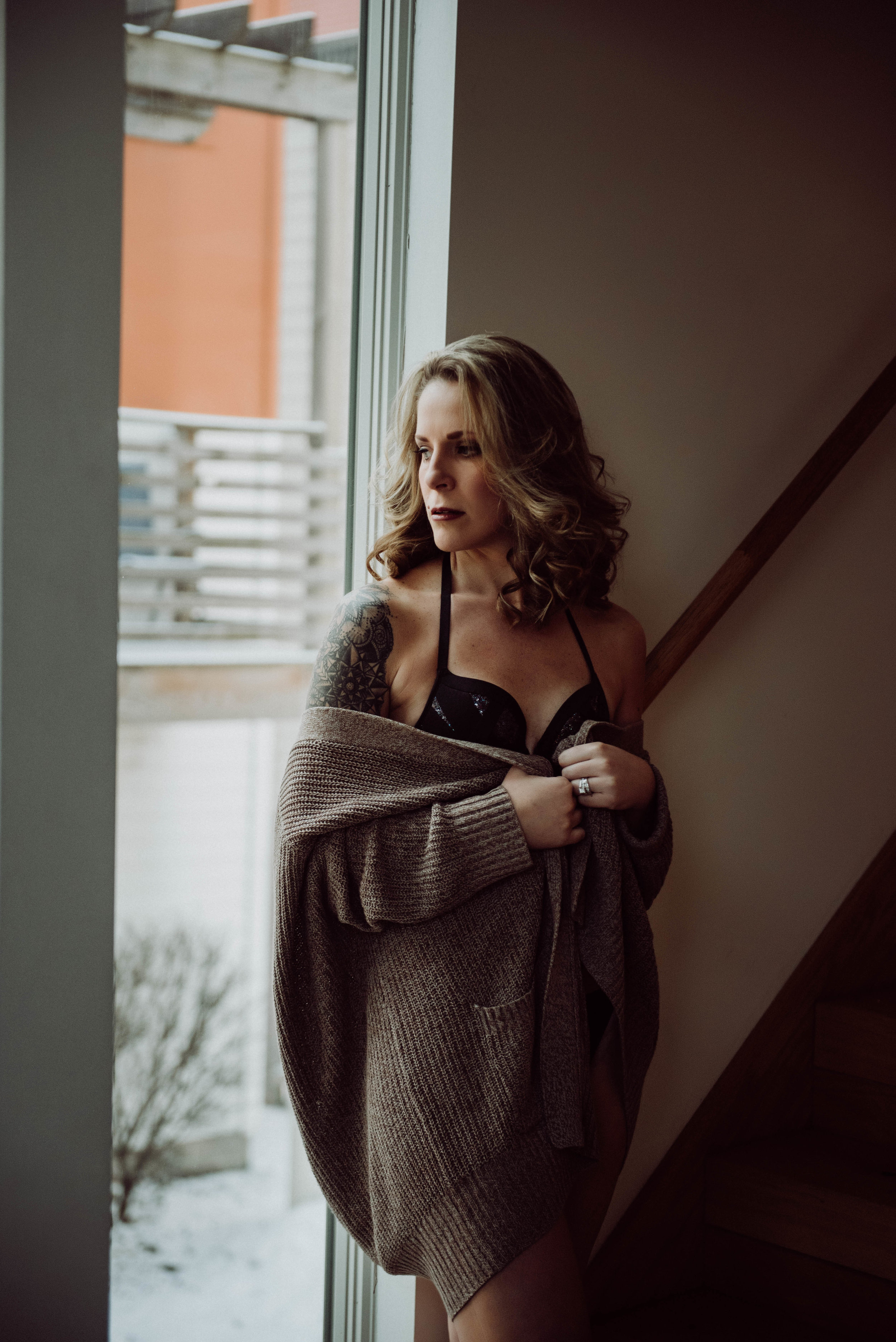 Curly hair blonde in sweater with black top boudoir photography New York City