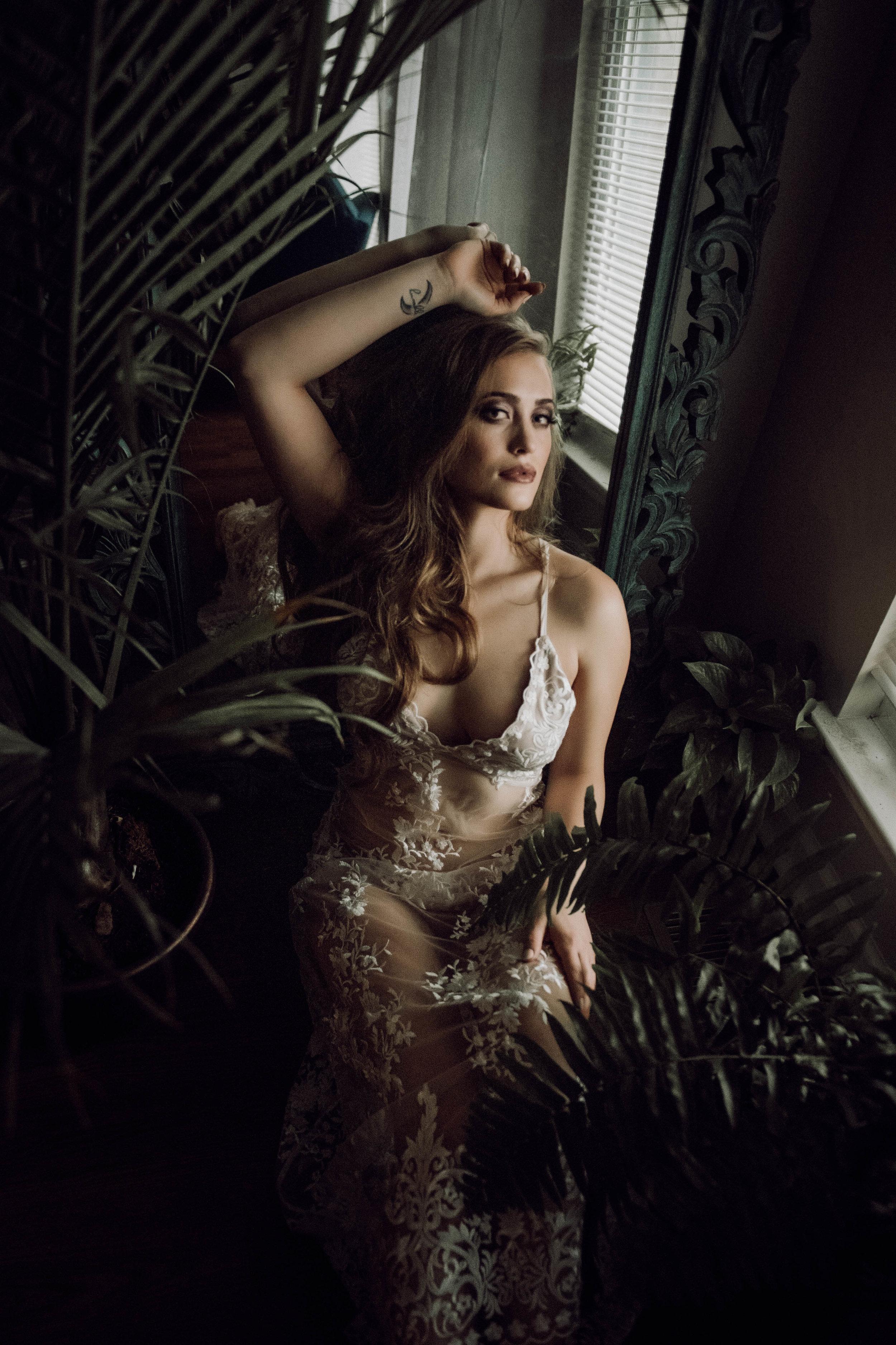 Beautiful blonde in white bodysuit mirror bedroom boudoir photography new york city studio