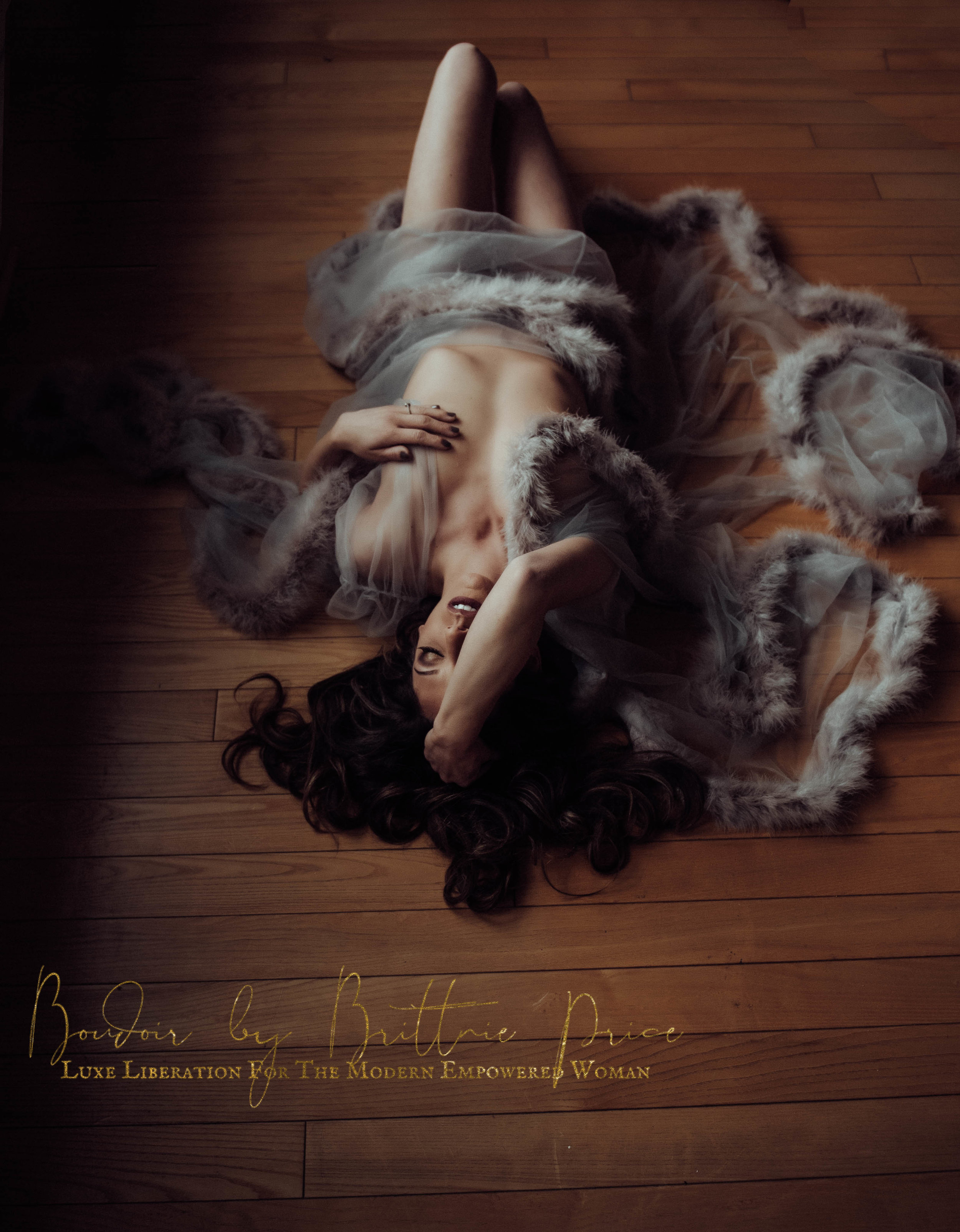 brunette woman laying on wood floor in gray lace robe boudoir photography new york studio