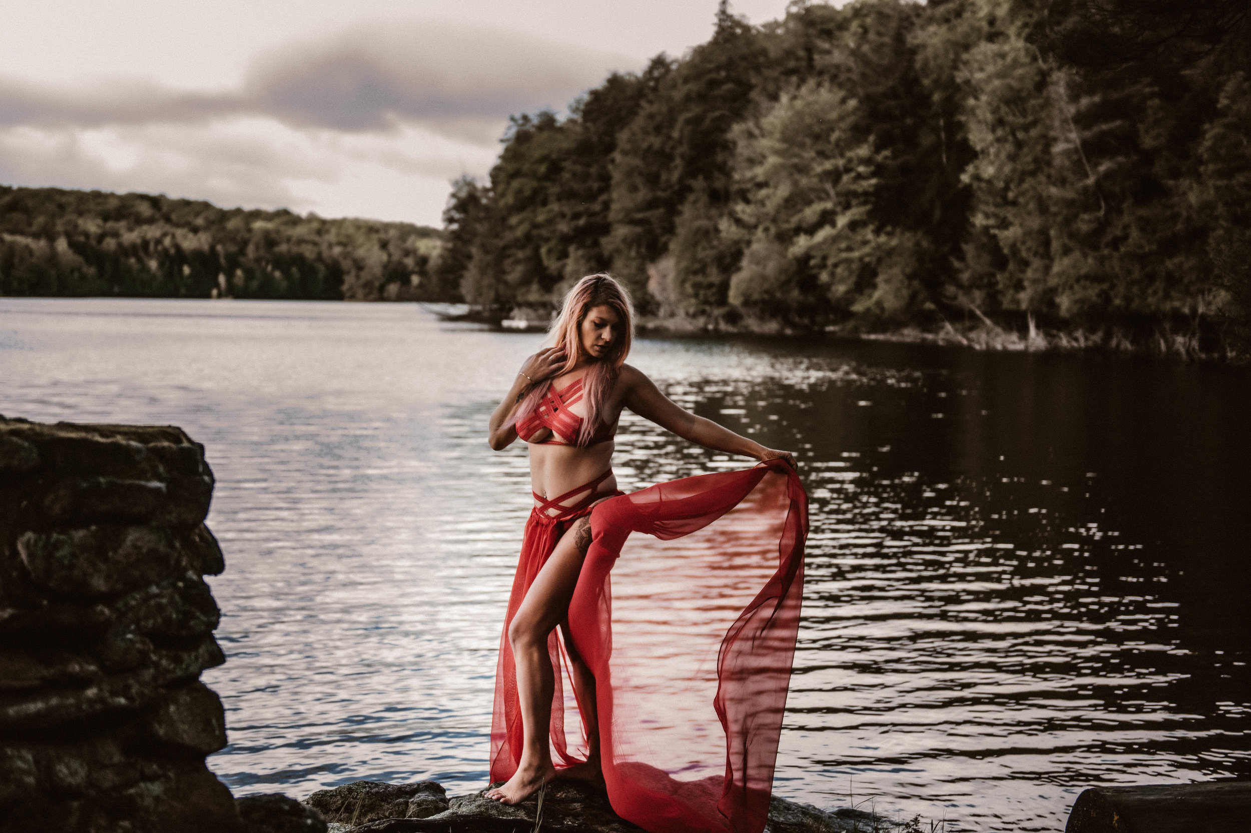 Boudoir photography at lake in red outfit outdoors in New York City