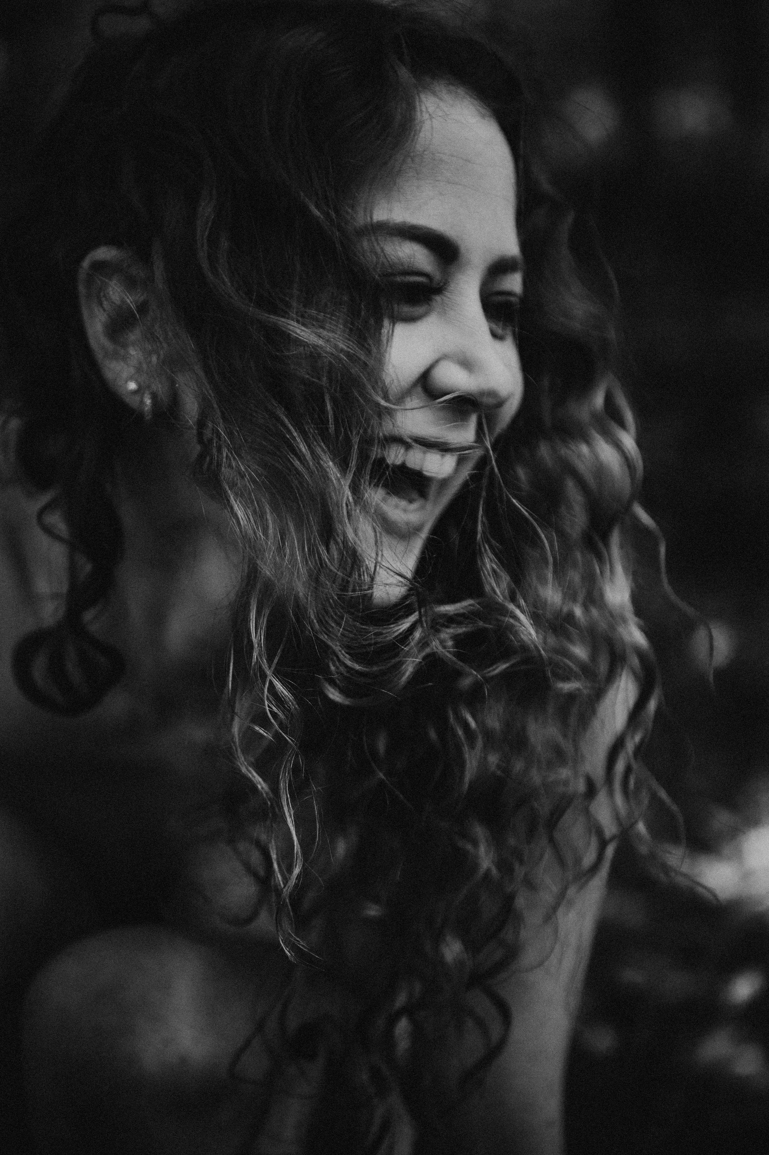 Close up black and white laughing portrait curly hair woman Taylor Oakes New York Boudoir studio
