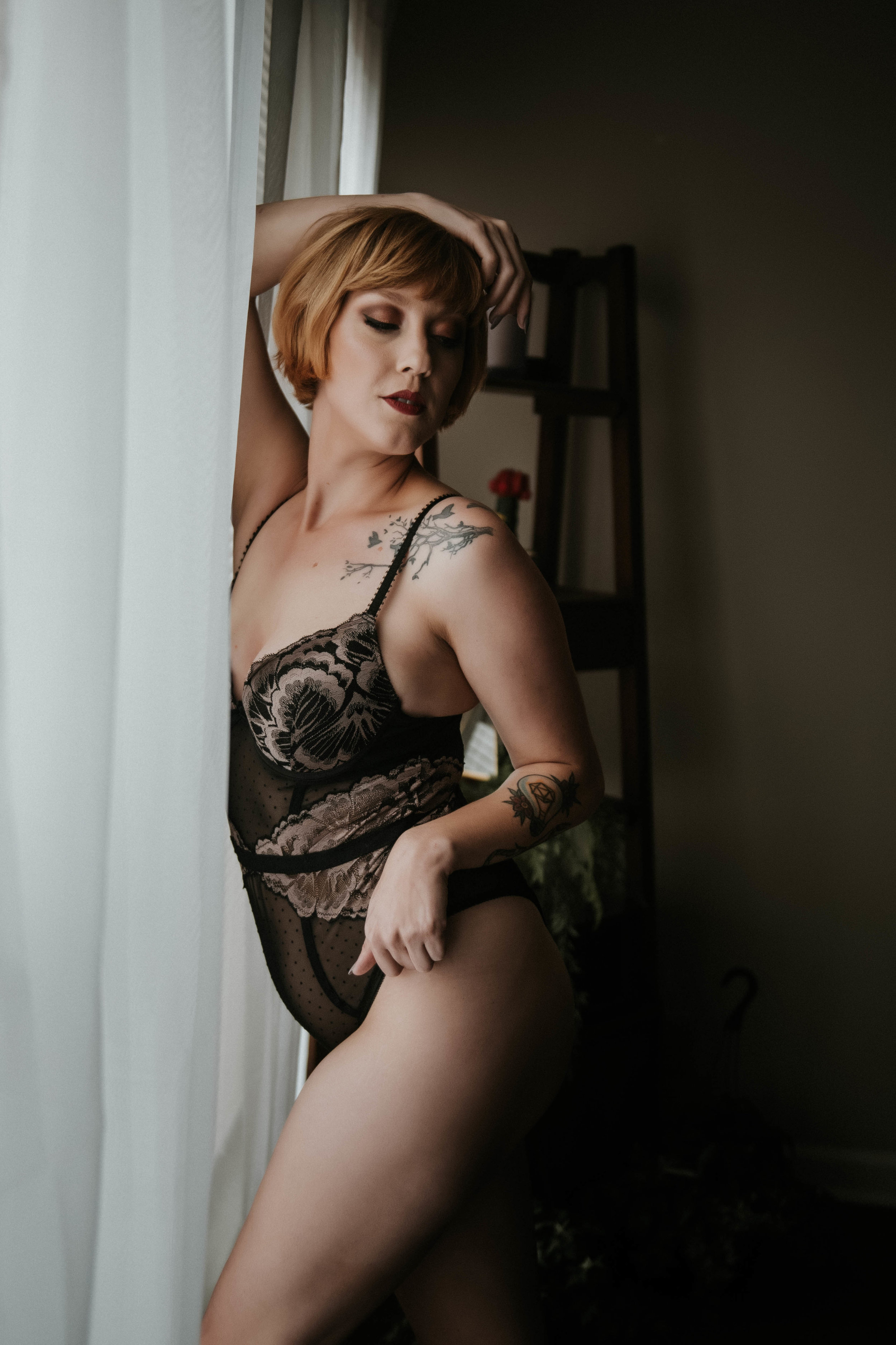 Short haired redhead in black lace bodysuit boudoir photography new york city studio