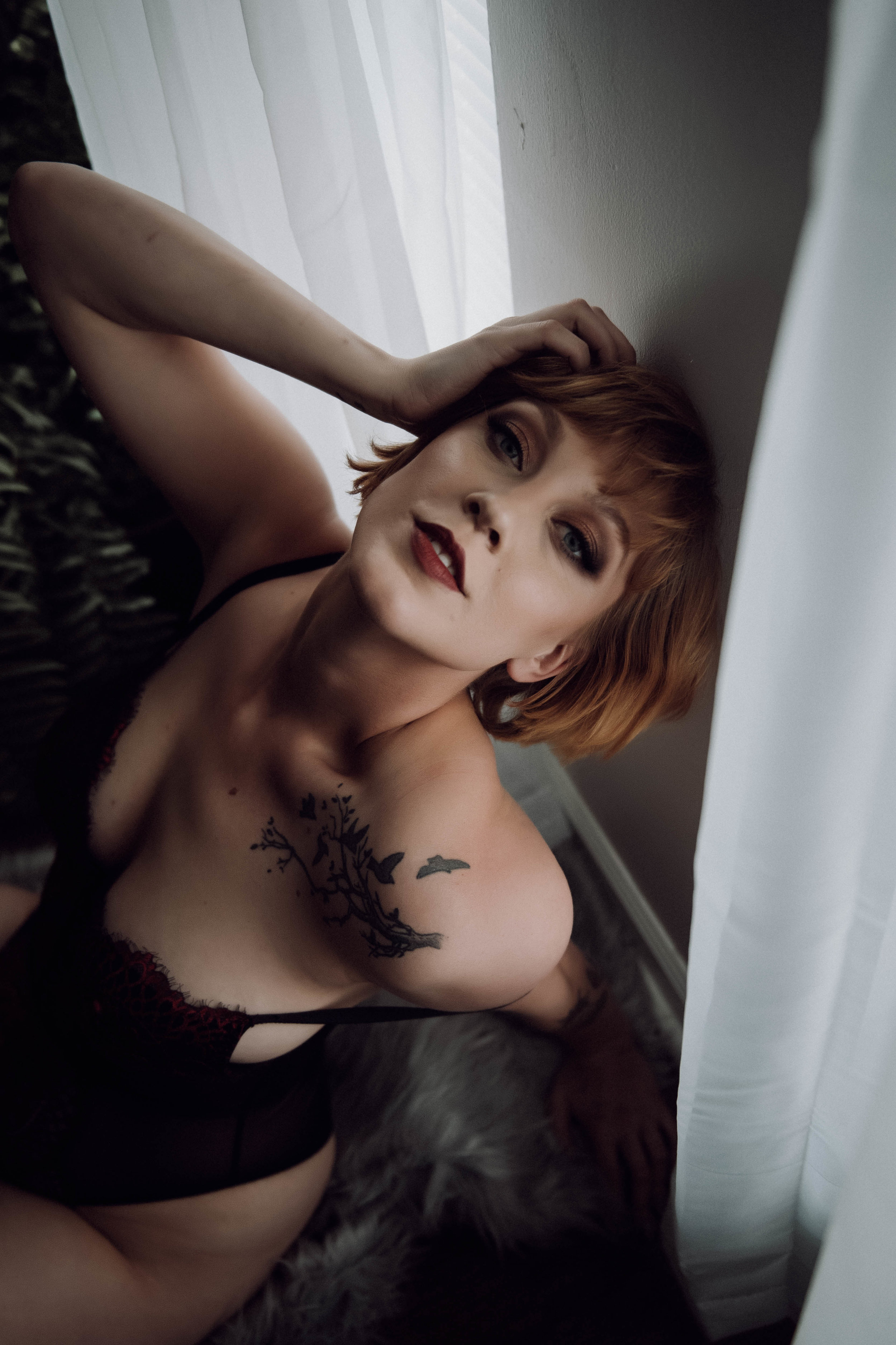 Close up intimate portrait redhead woman with blue eyes boudoir photography new york studio