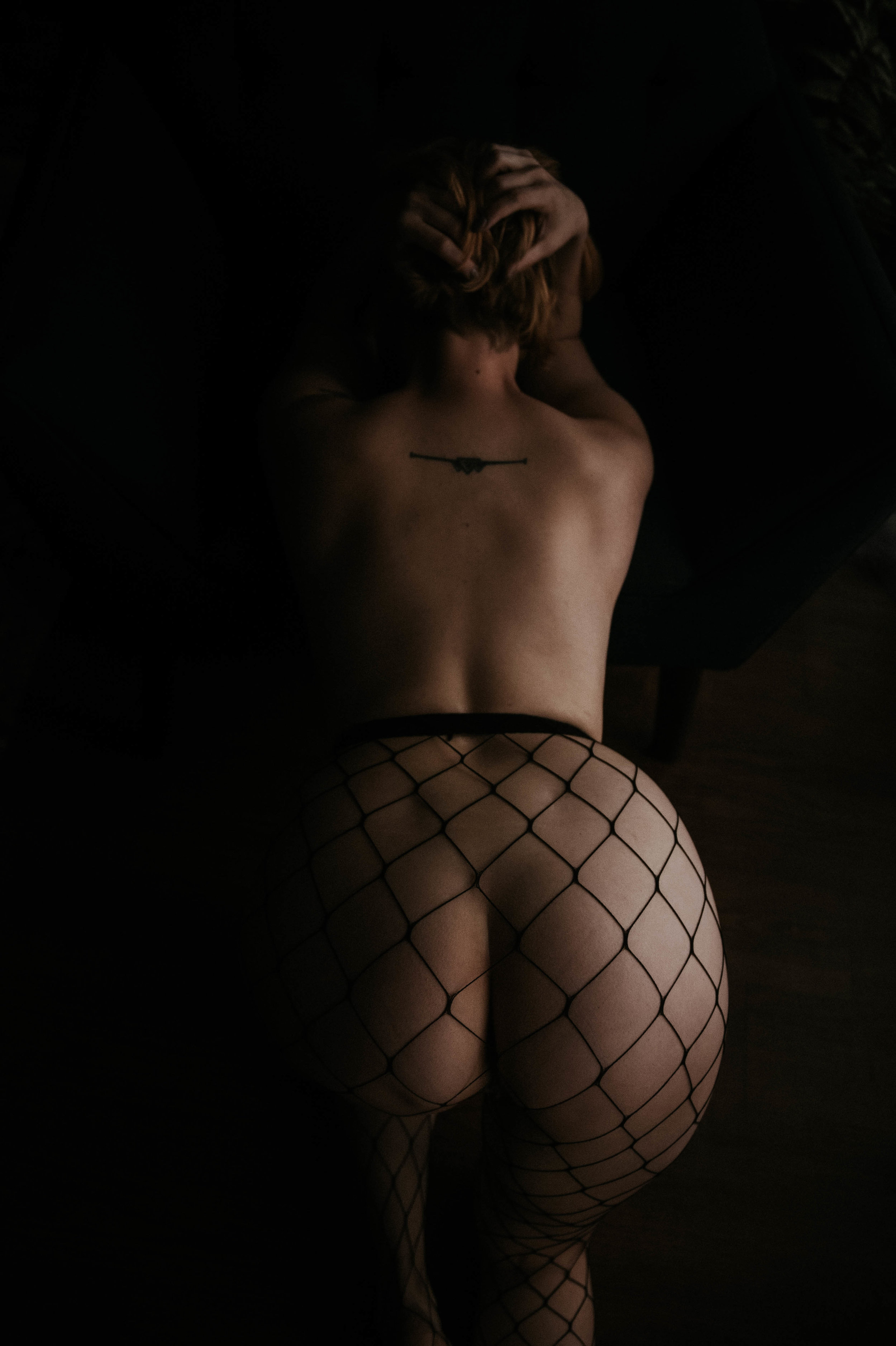 Nude redhead woman in black fishnets kneeling boudoir photography new york studio