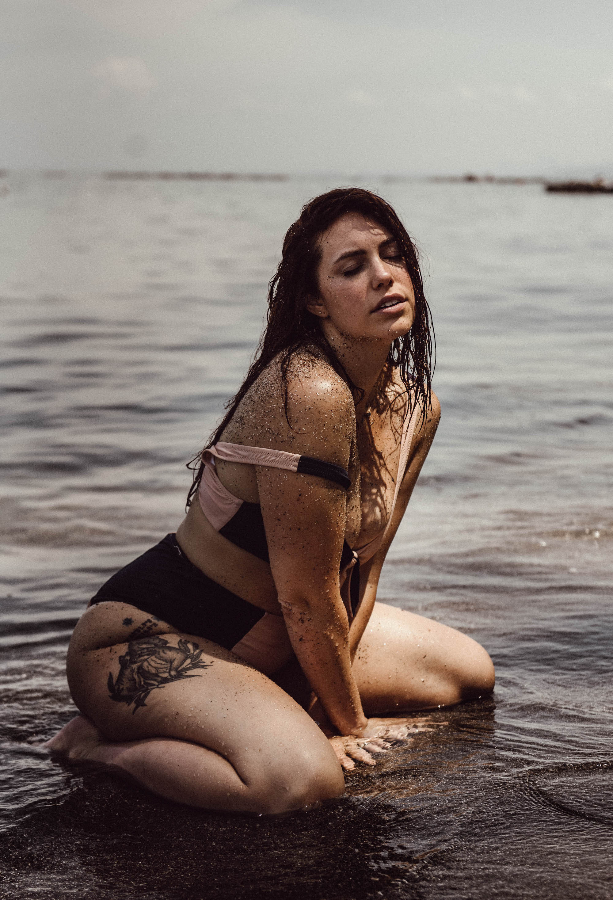 Brunette woman in bathing suit in lake intimate boudoir photography New York City outdoors