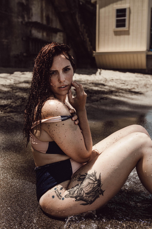Brunette woman in bikini in lake intimate boudoir photography New York City outdoors