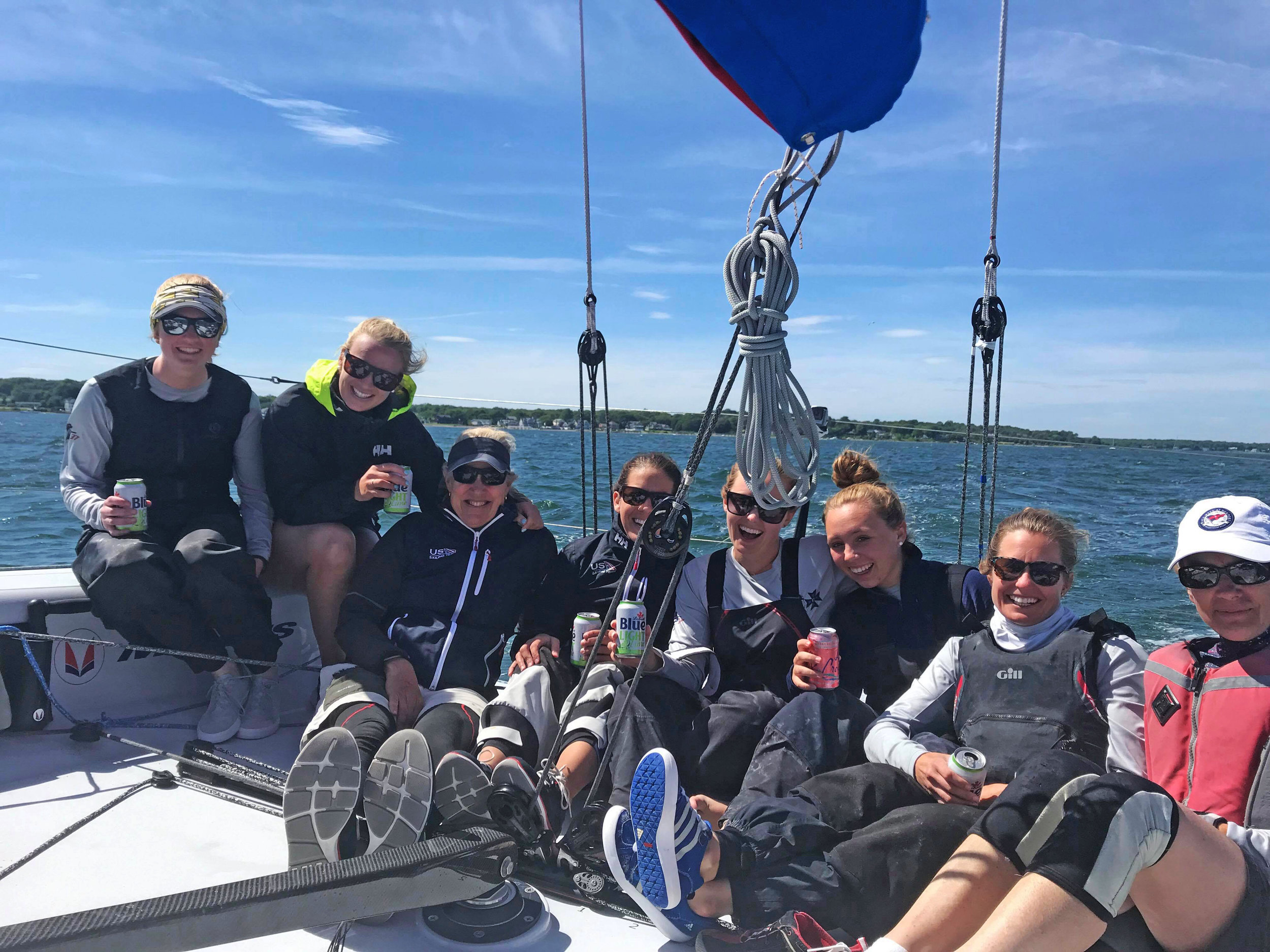From Left: Amina Brown (runners), Katja Sertl (trimmer 1), Cory Sertl (co-skipper/tactician), Meredith Carroll (mast), Hollis Barth (trimmer 2), Colette Fortenberry (float, squirrel, assistant), Hillary Noble (bow), Kathy Kirk (pit)