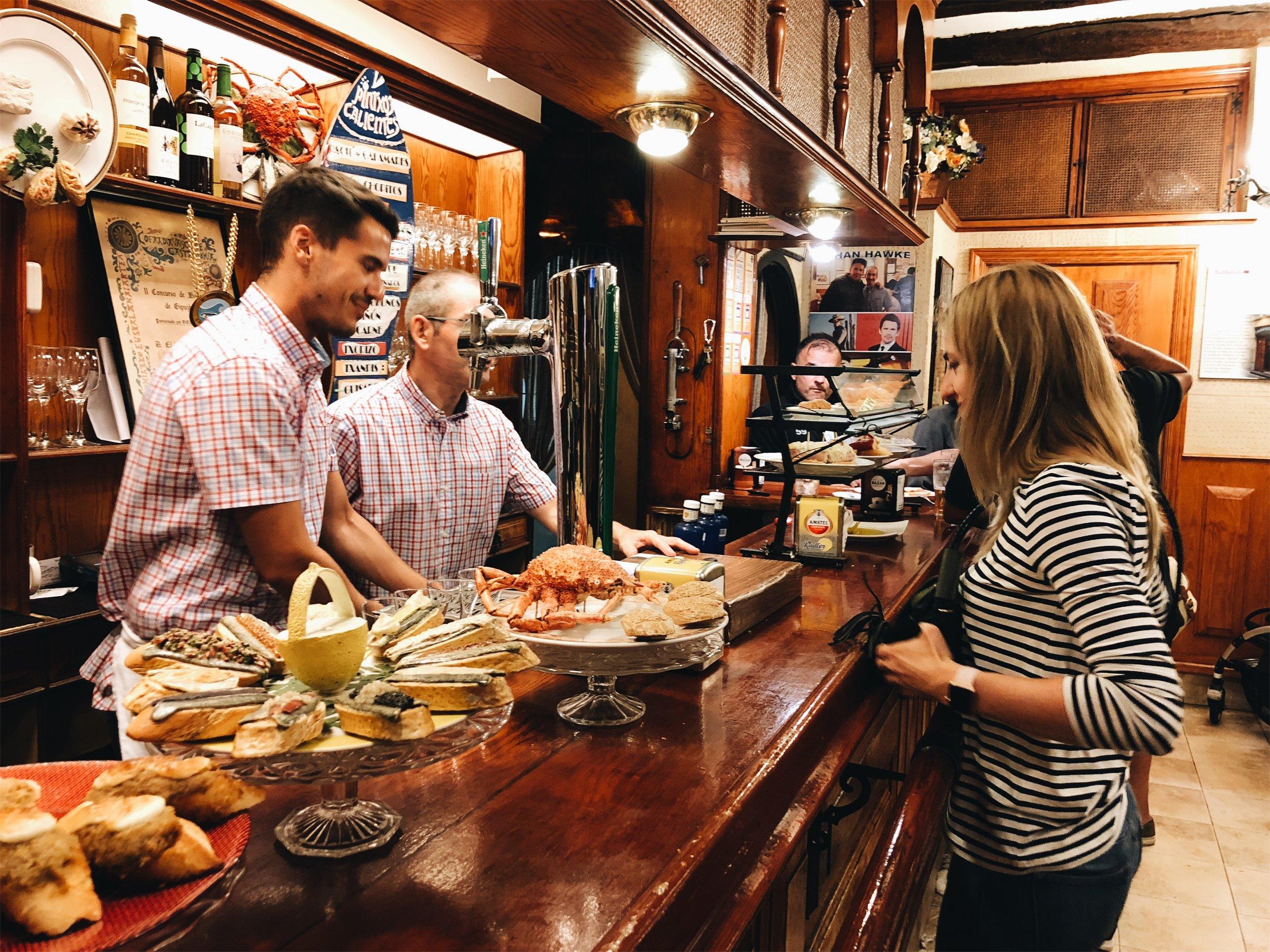 ordering pinchos in Old Town San Sebastian at Txepetxa