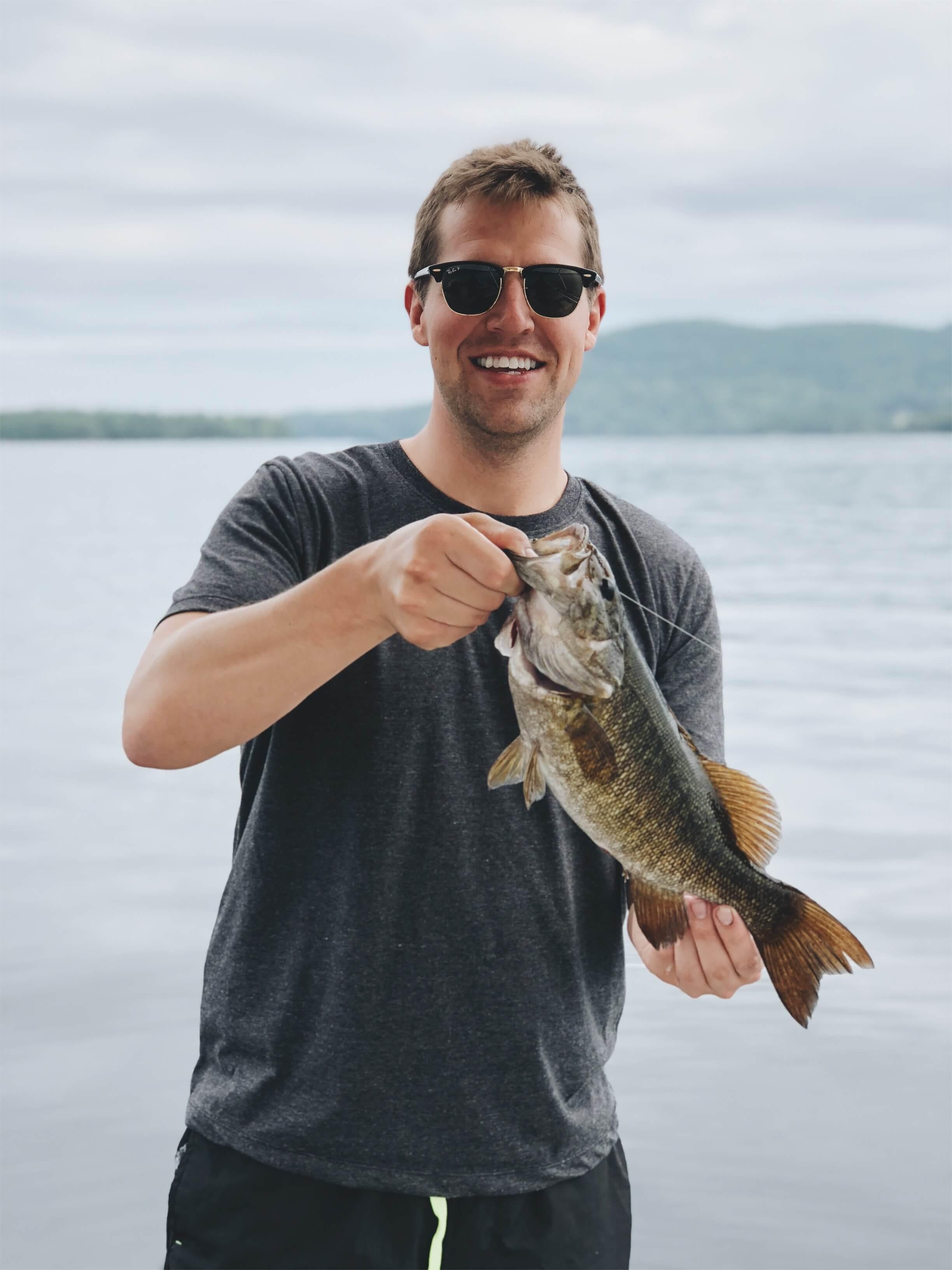 Catching small mouth bass fishing Squam Lake