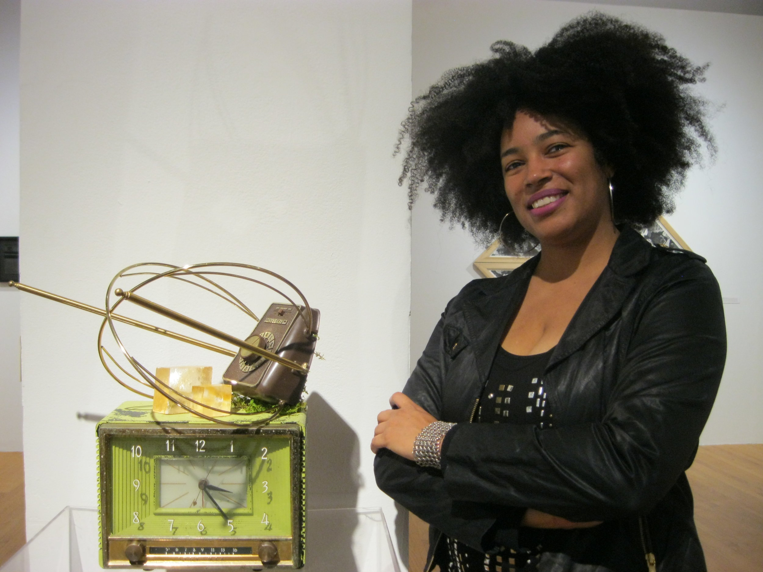Rhonda with one of her sculptures in the Silos exhibition, at Glass Curtain Gallery, Columbia College.