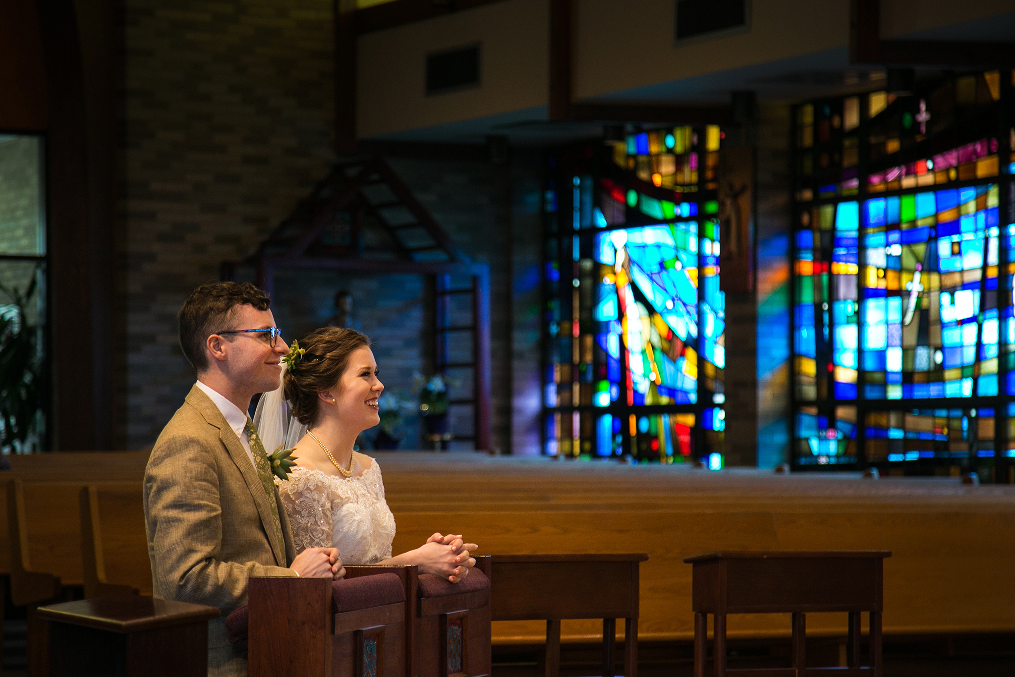 bride and groom stained glass church ceremony